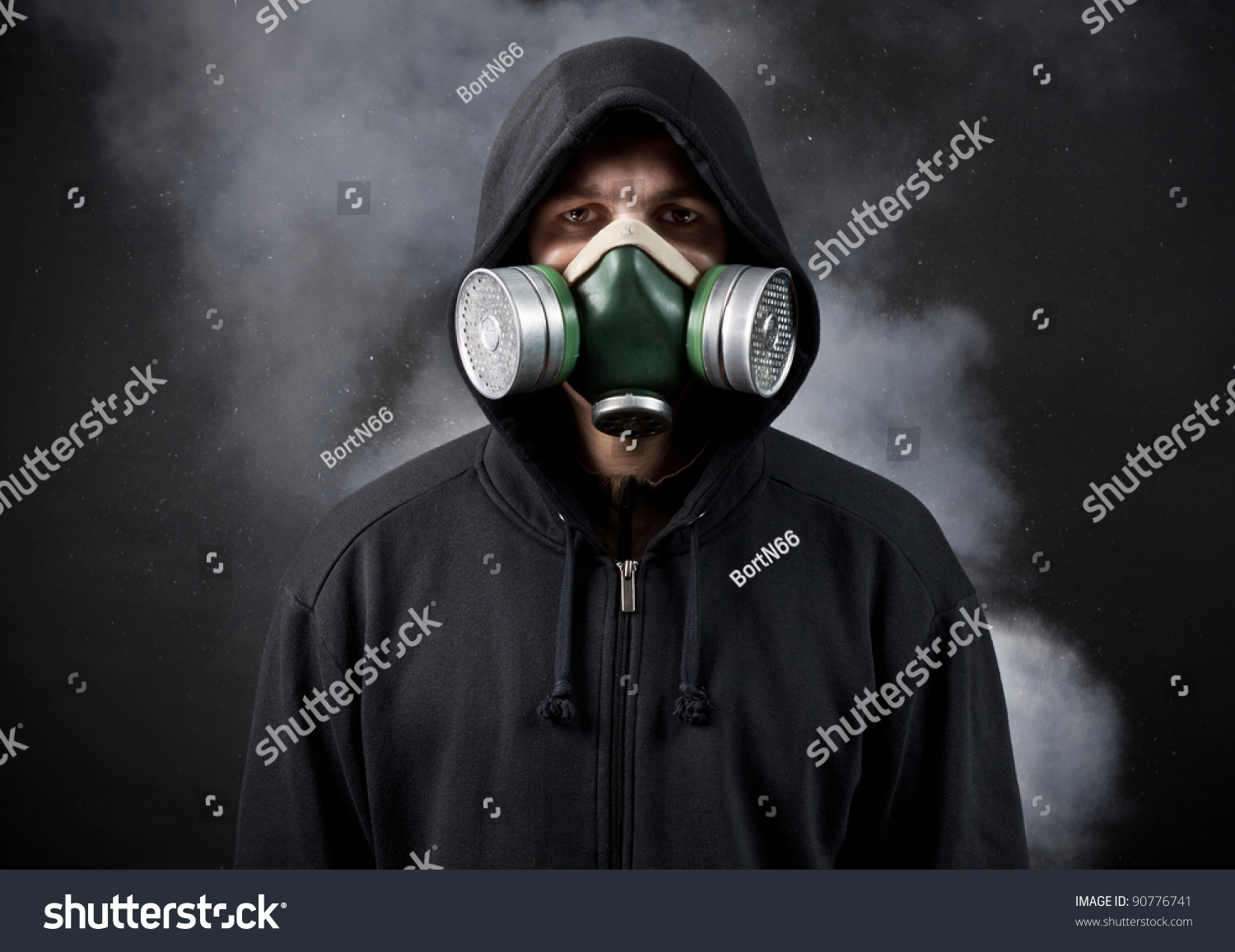 http://image.shutterstock.com/z/stock-photo-the-young-man-in-a-hood-and-in-a-respirator-90776741.jpg