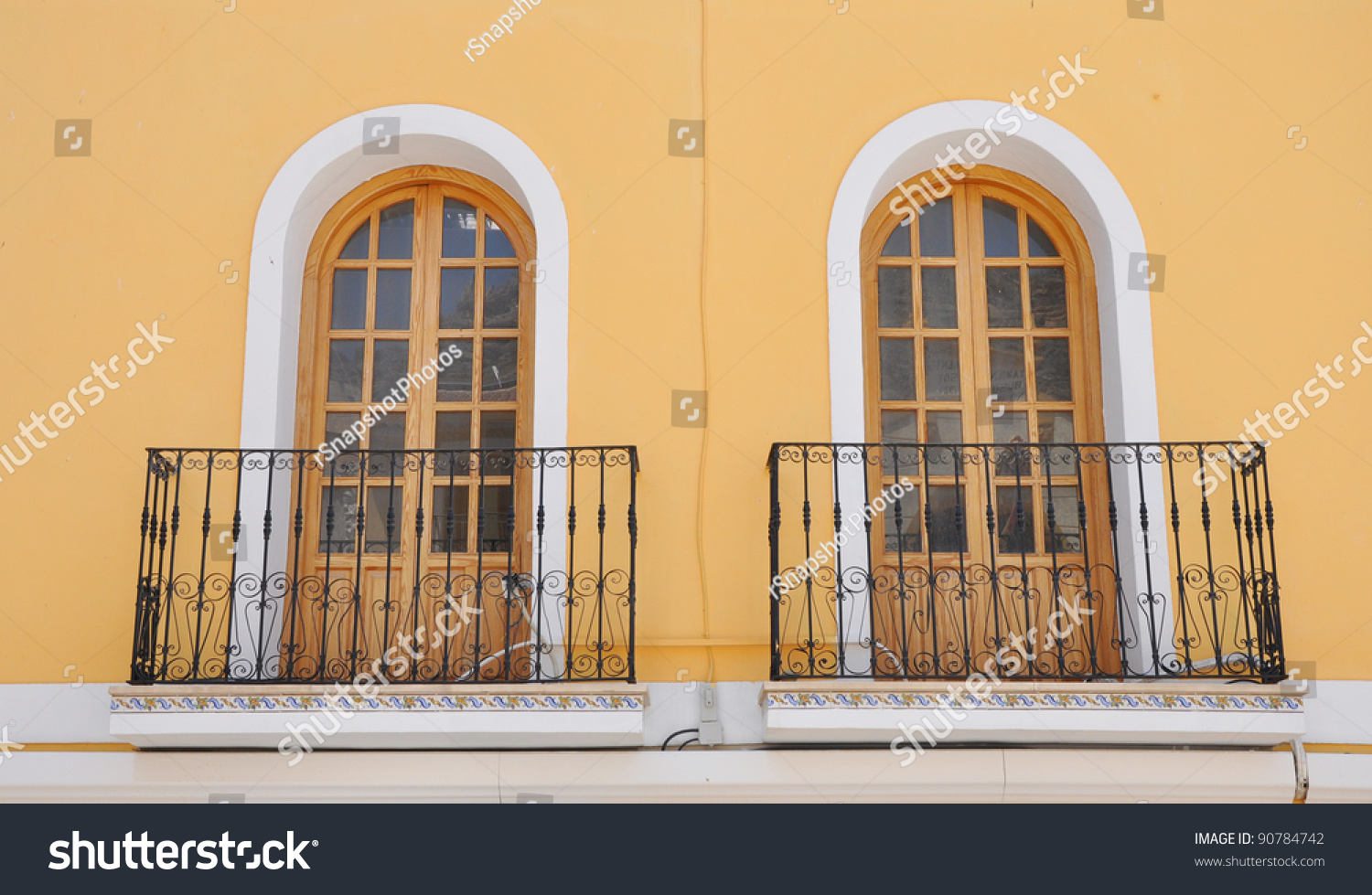 Two Mediterranean Style Windows With Terrace Railing