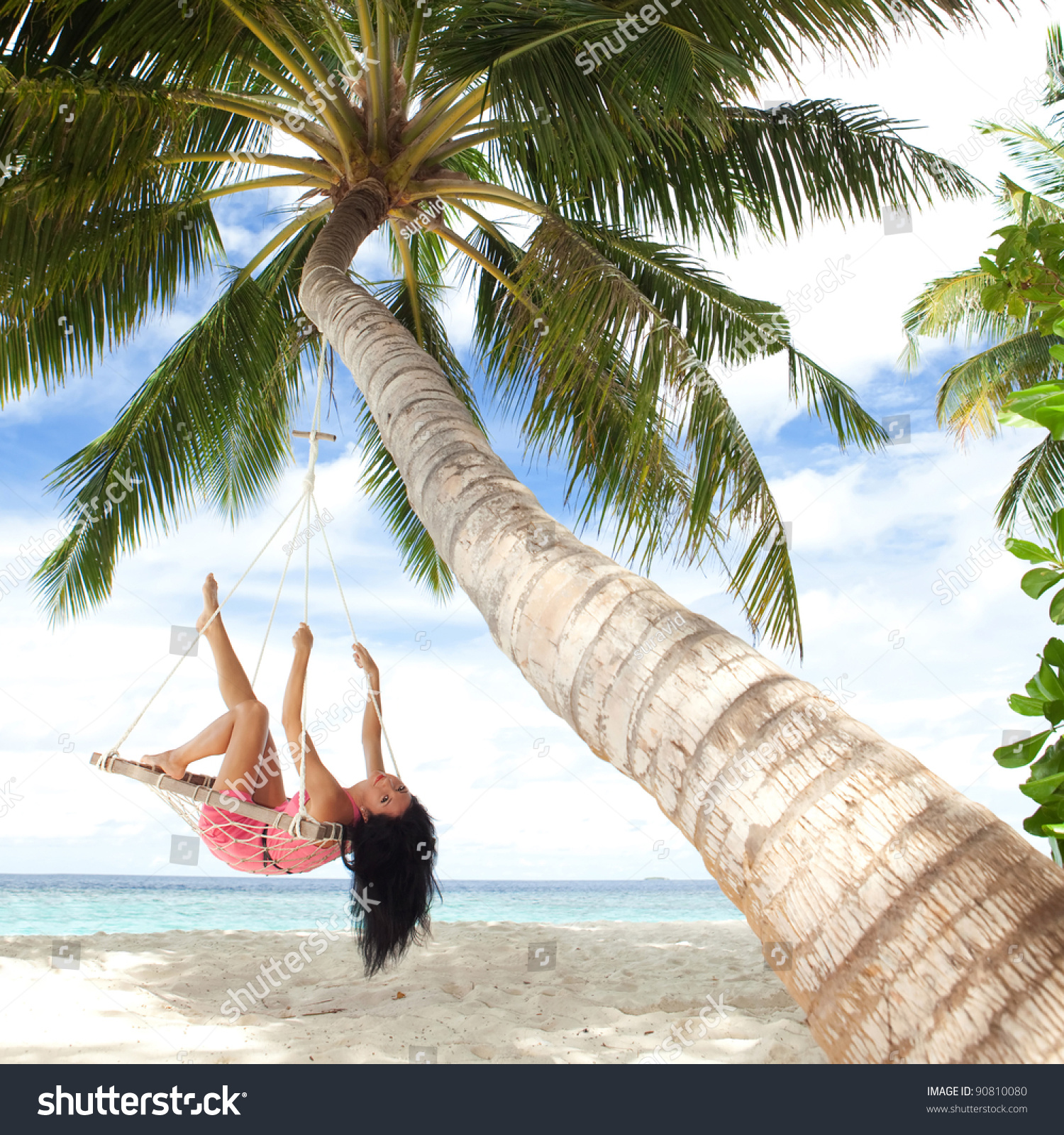 Happy Woman Relaxing In Hammock On A Tropical Beach Stock