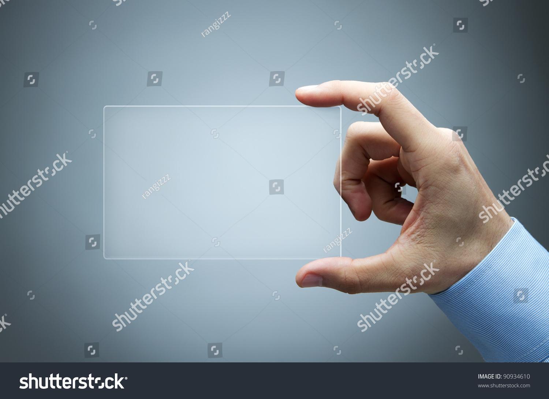 Technology Management Image: Human Hand Holding Futuristic Business Card Stock Photo