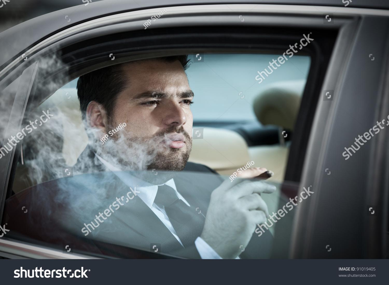 wealthy man back seat car smoking stock photo 91019405