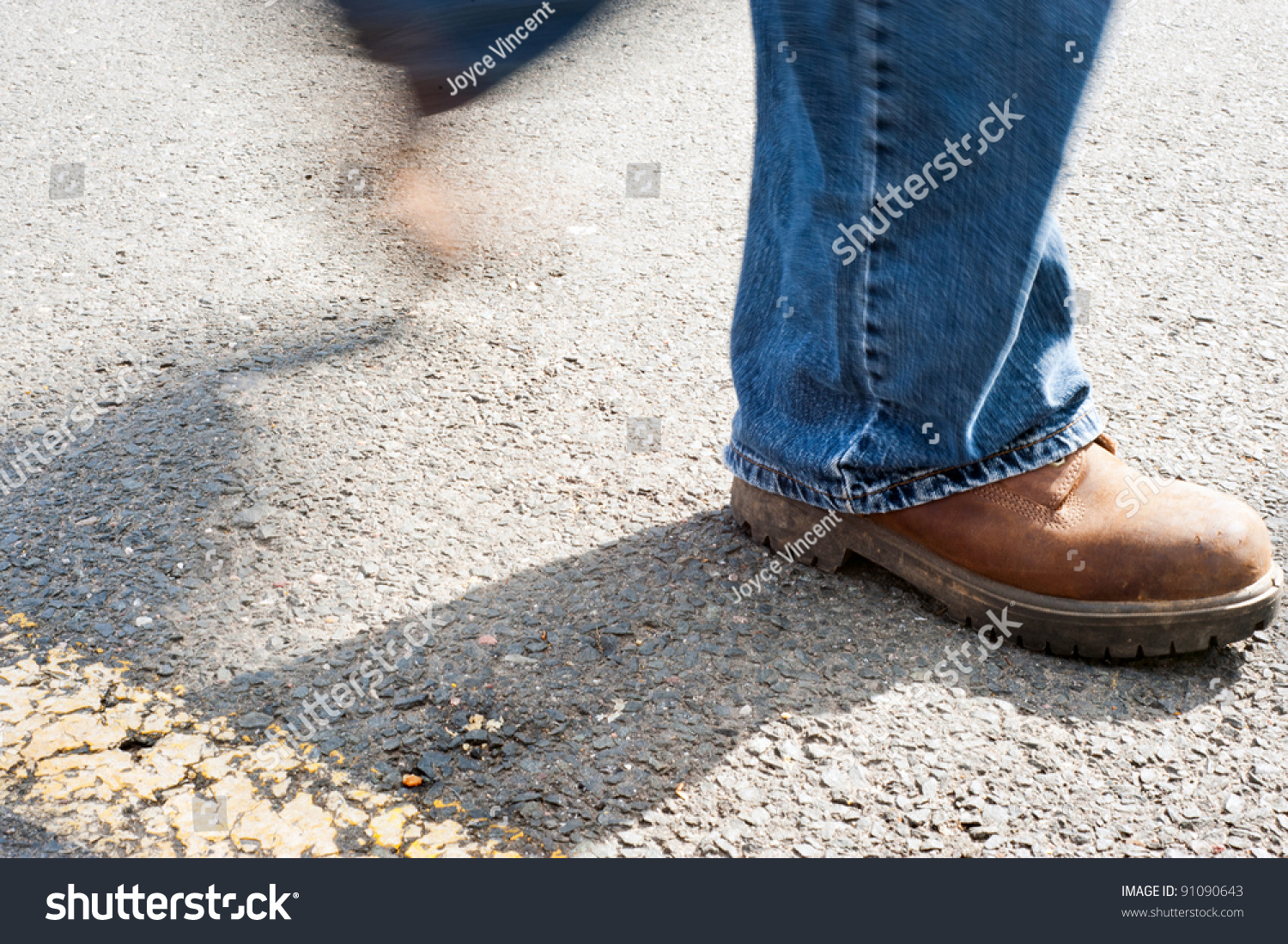 a walking on concrete with work boots on stockfoto