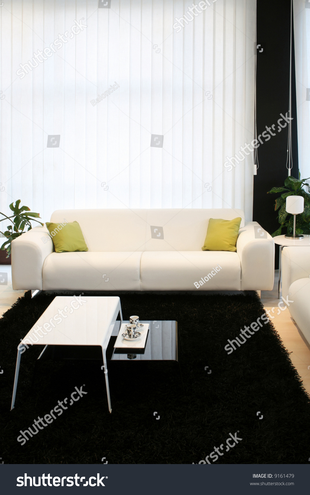 living room with white sofa and black carpet stock photo 9161479