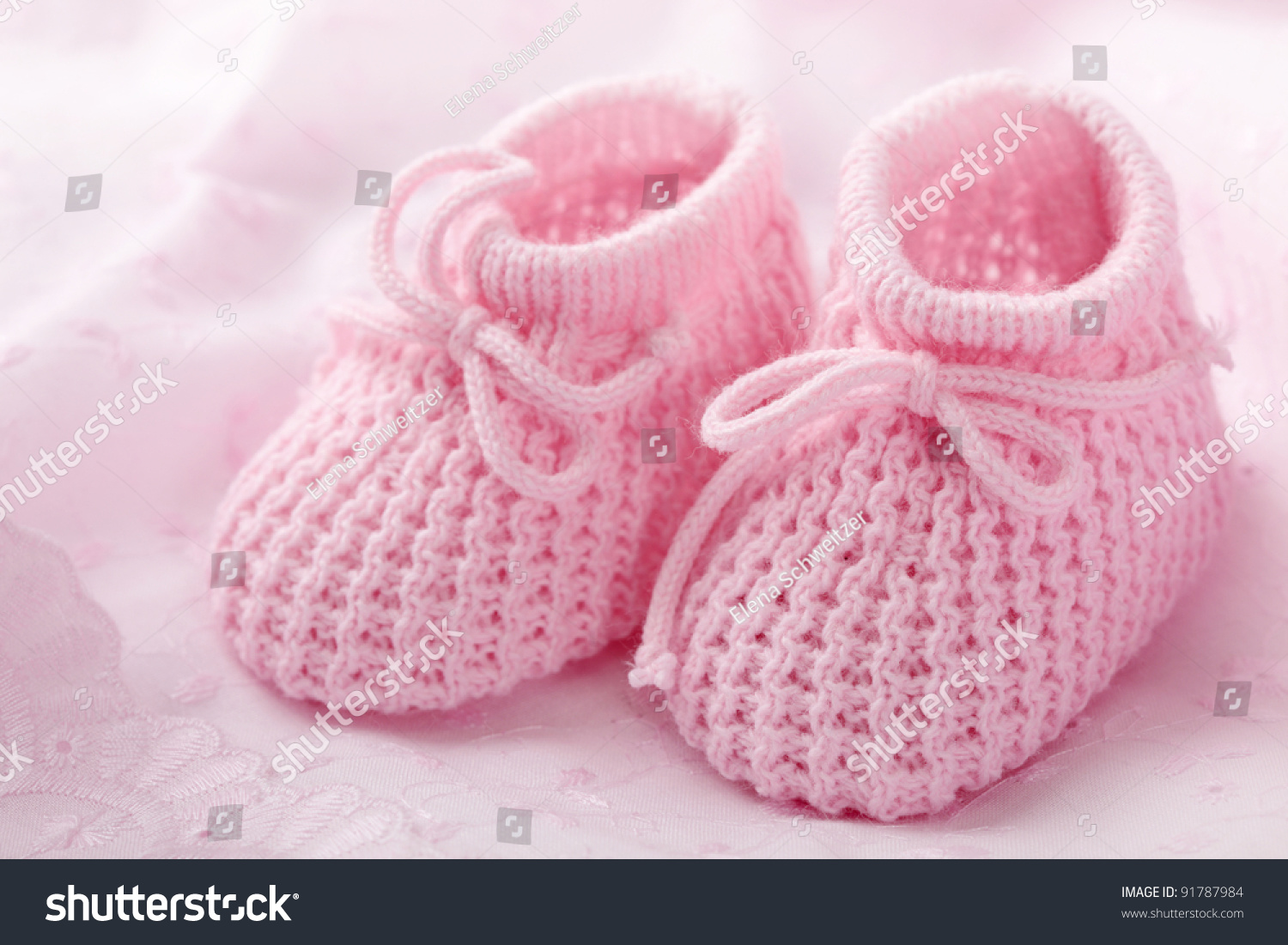 Pink Baby Booties On Pink Background Stock Photo 91787984