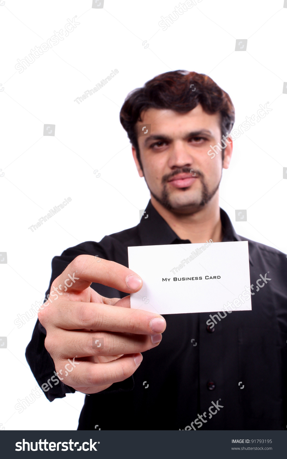 Young indian guy showing his new stock photo edit now 91793195 a young indian guy showing his new business card focus on the hand and card colourmoves