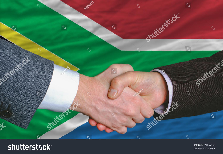 Two Businessmen Shaking Hands After Good Business Investment – Business Investment Agreements