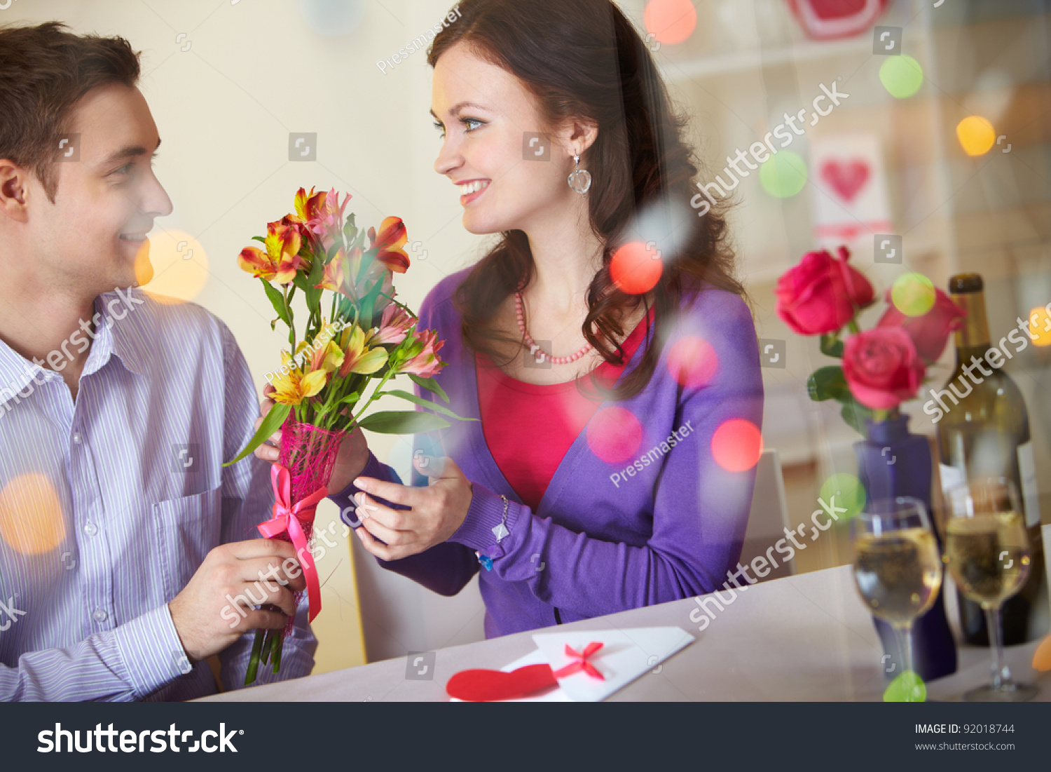 Young man giving floral bouquet pretty stock photo edit now a young man giving floral bouquet to pretty girlfriend mightylinksfo