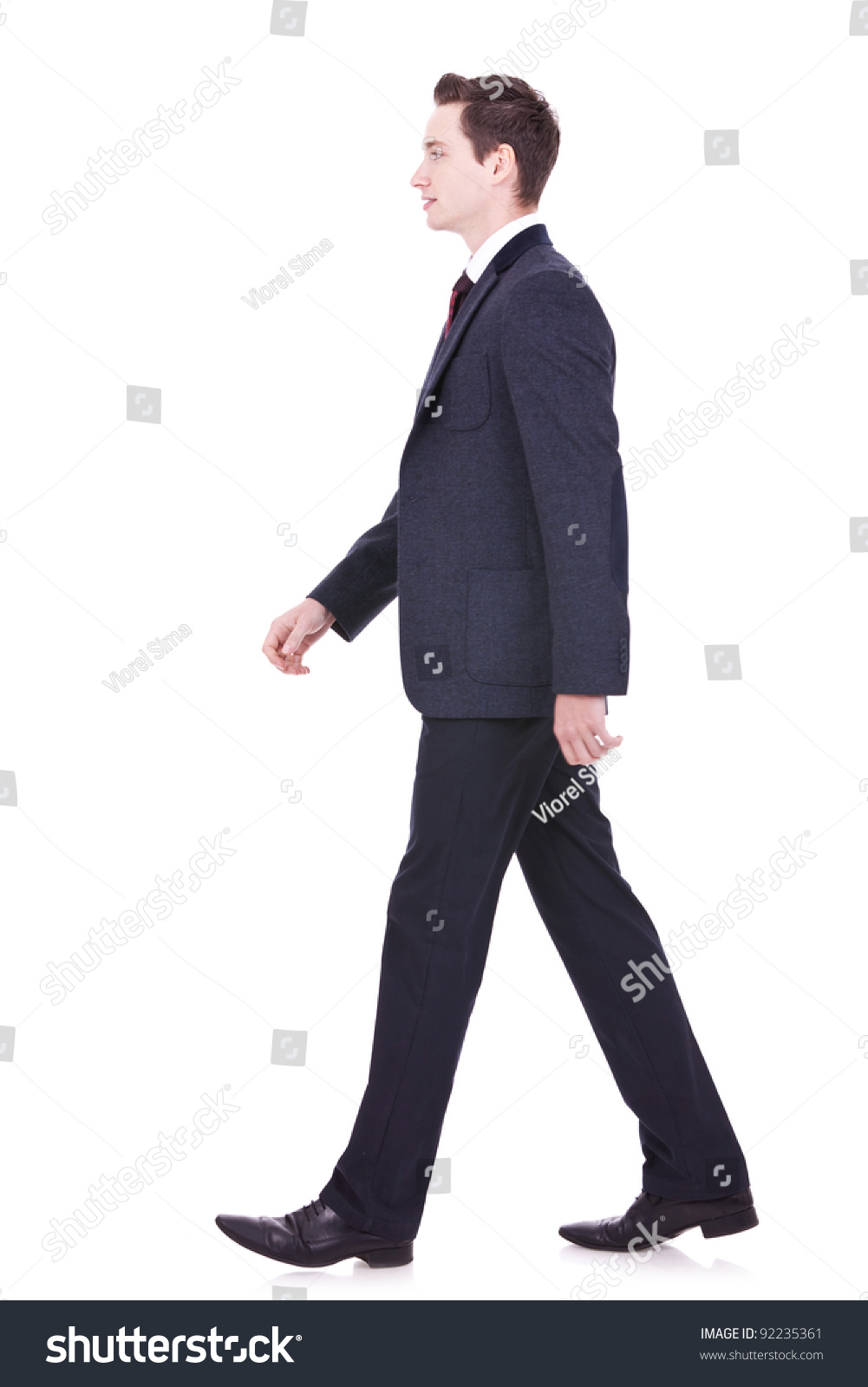 stock-photo-picture-of-a-young-business-man-walking-forward-side-view-92235361.jpg