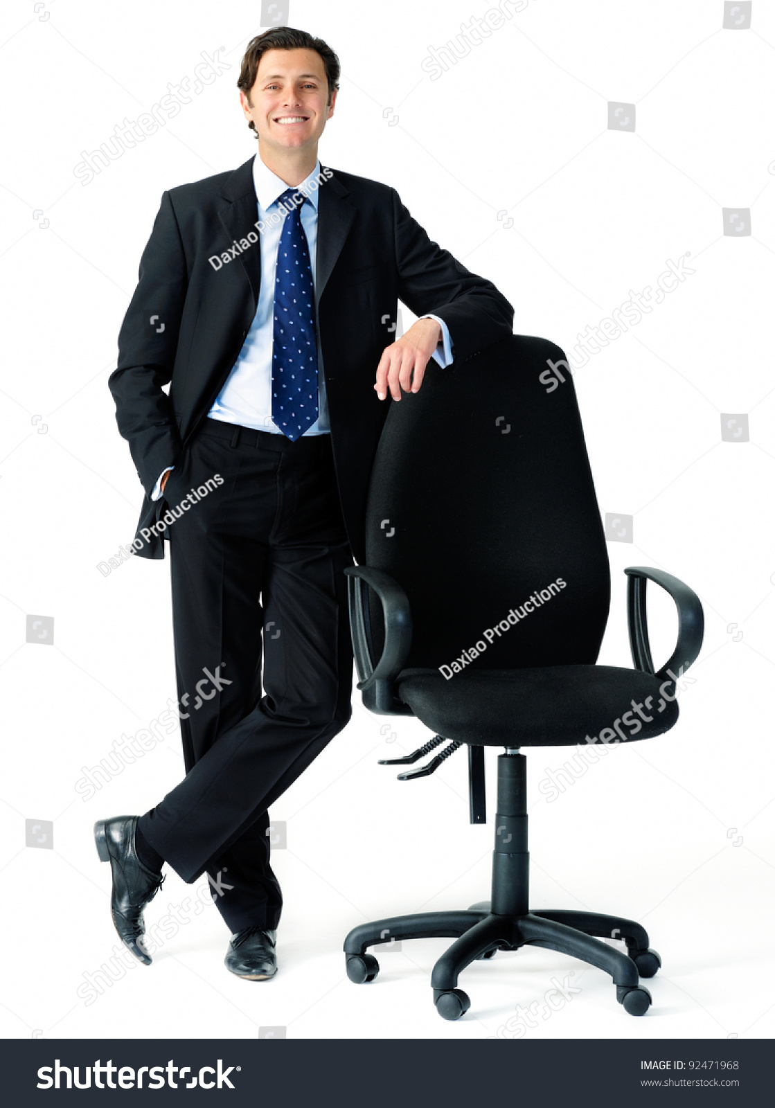 smart looking businessman leans on an empty office chair to save to a lightbox