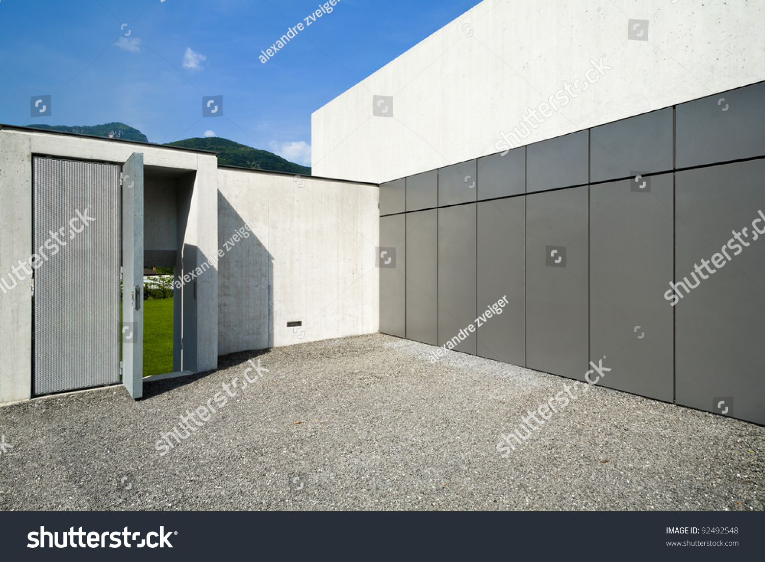 Modern house the garage entrance stock photo 92492548 for Entrance from garage to house