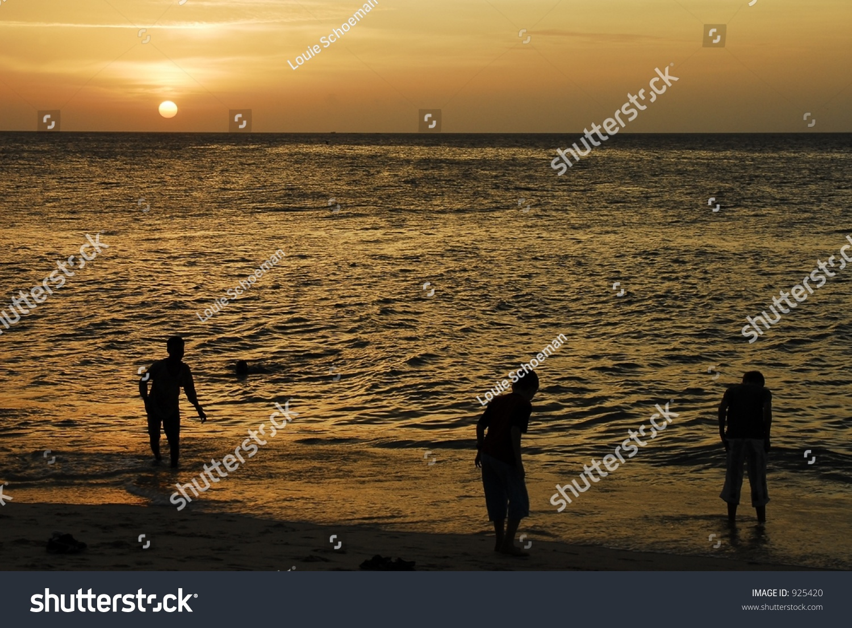 Children Playing On Stowntown Beach At Sunset, Zanzibar ...