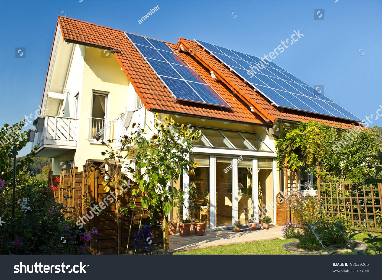 House garden solar panels on roof stock photo 92639266 for Solar panel house plans