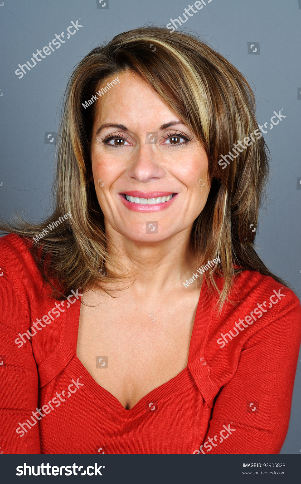Attractive Middle Aged Woman in Red Sweater