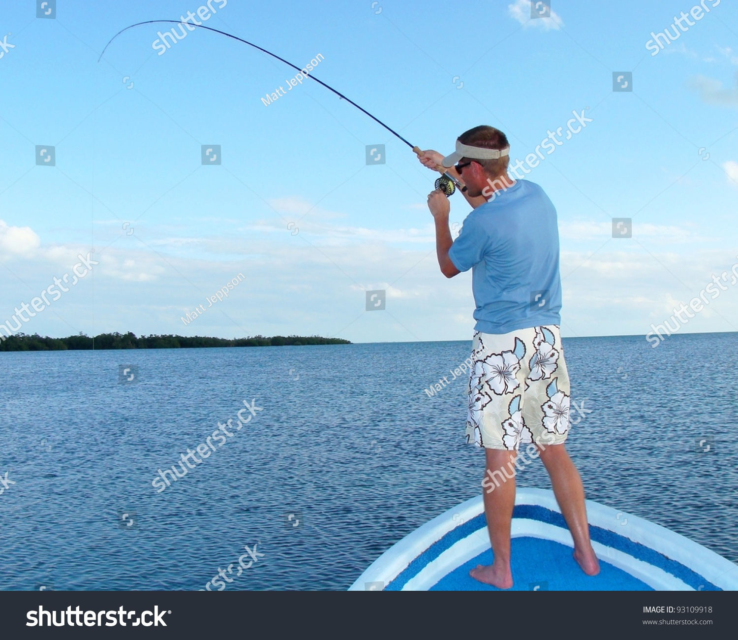 Saltwater fly fishing for bonefish fighting a big fish for Big fish in the ocean