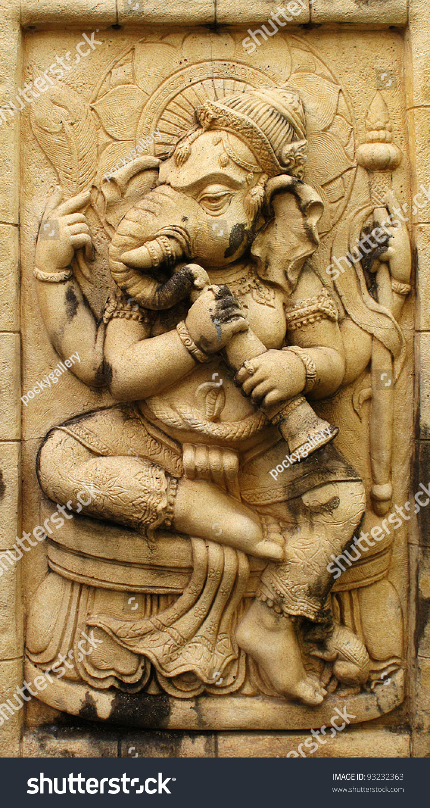 Ganesh hindu god made from stone carving stock photo
