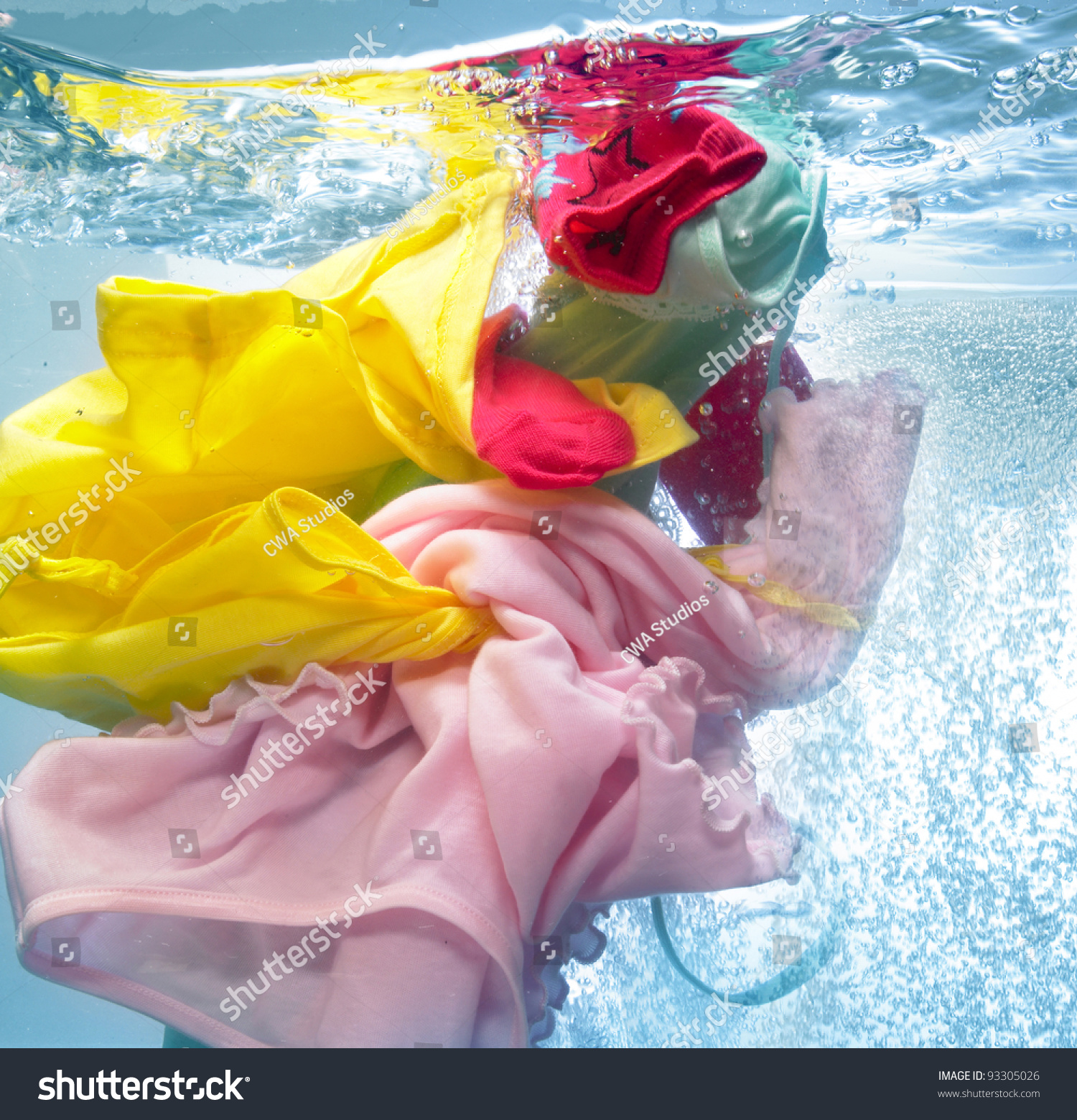 Colorful clothes in the washing machine stock photo 93305026 shutterstock - Protect clothes colors washing ...