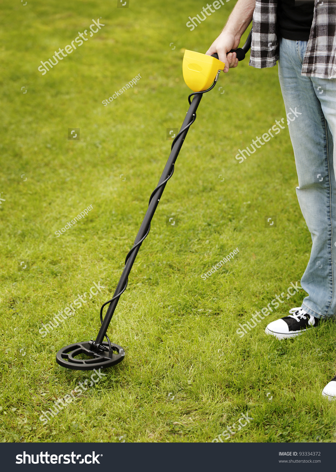 Jew Detector: Man Using A Metal Detector On Lawn. Stock Photo 93334372