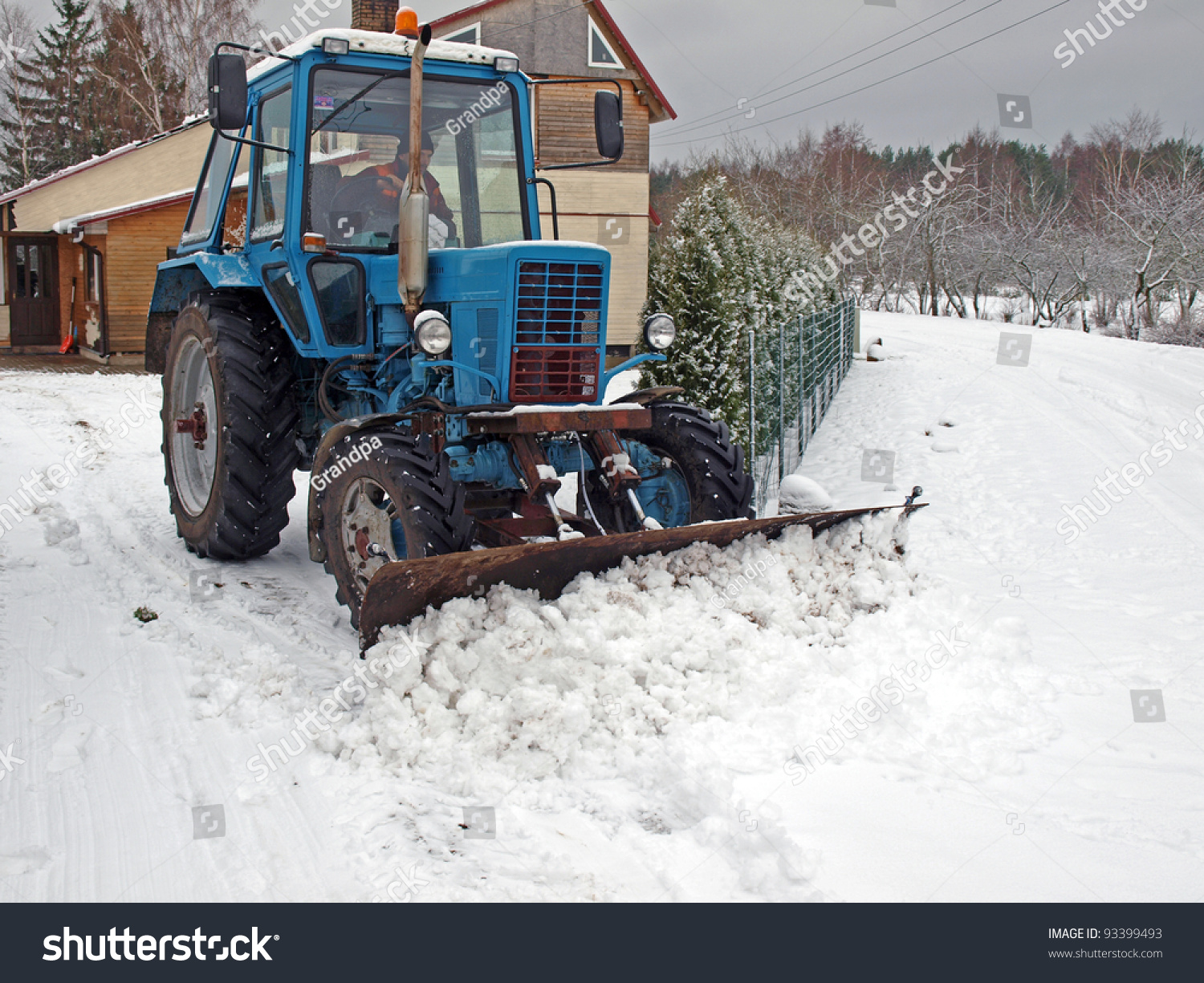 Tractor Plowing Snow On Country Yard Stock Photo (Edit Now