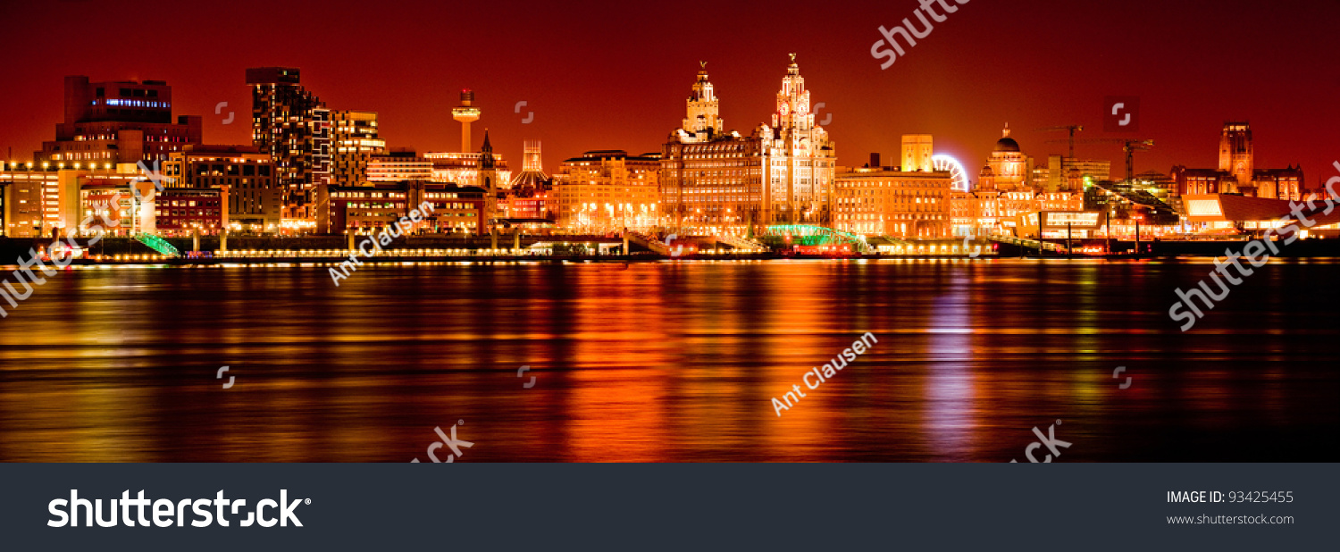 dramatic liverpool skyline night reflected mersey stock