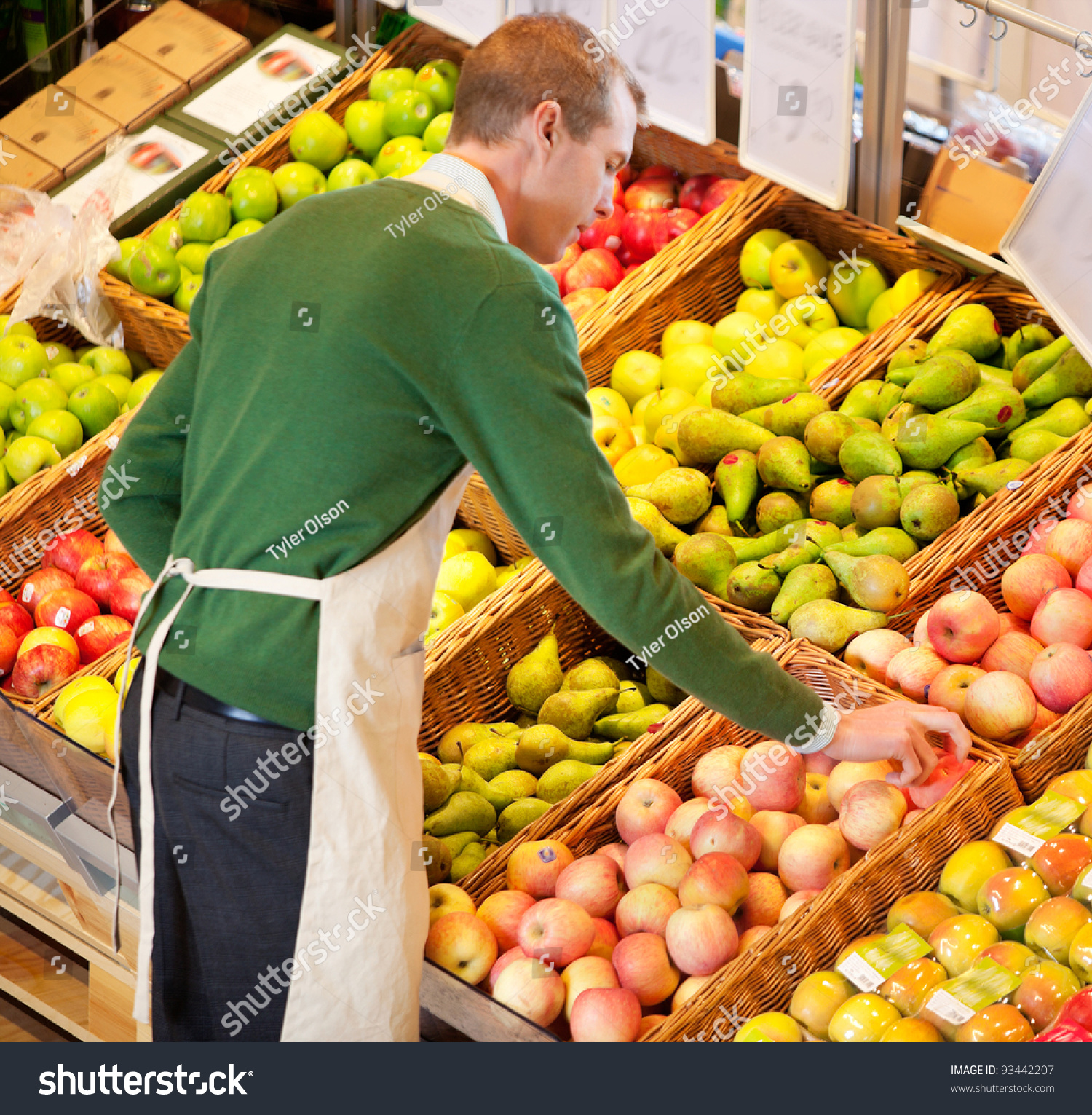 high angle view store worker working stock photo  high angle view of store worker working in a grocery store