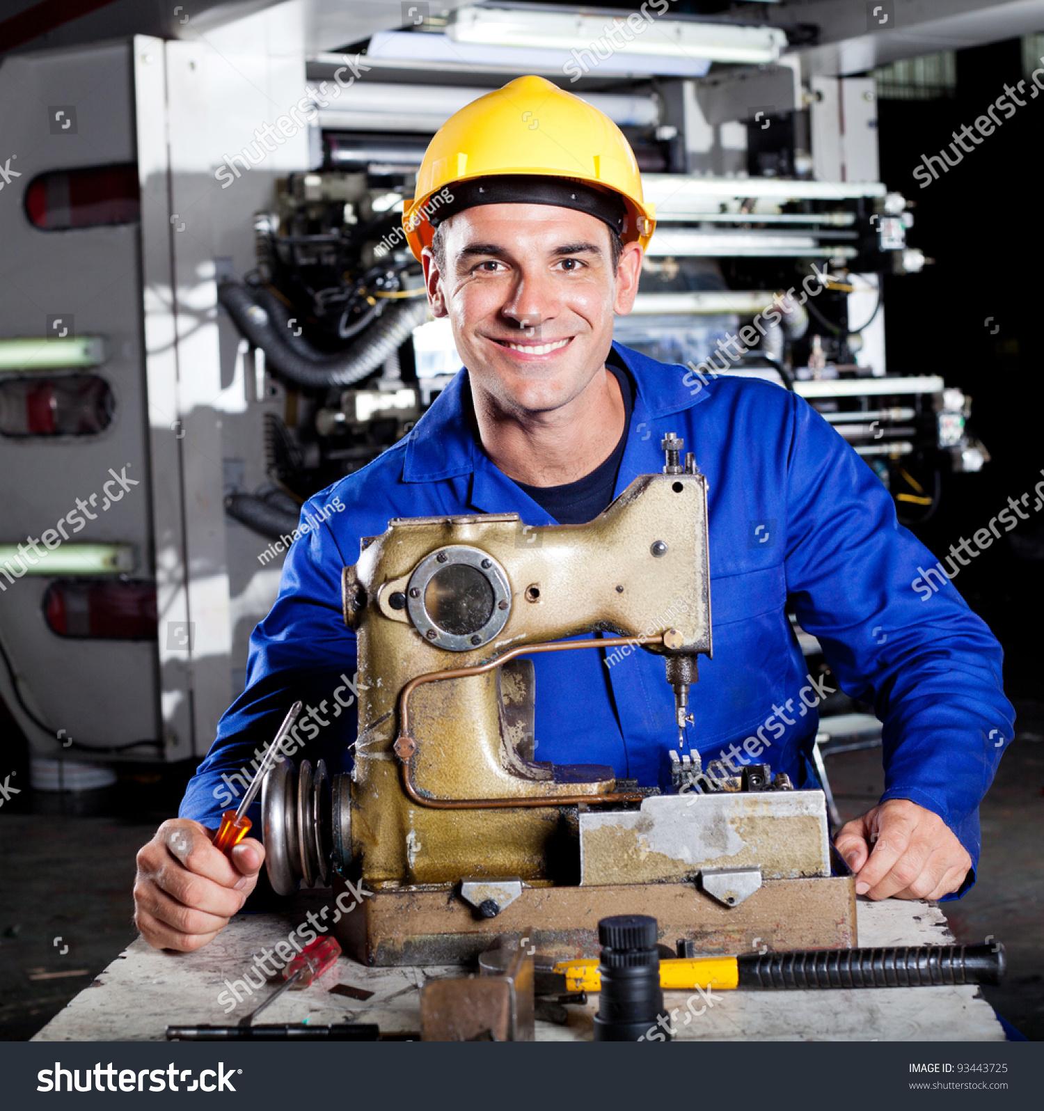Happy Mechanic Repairing Industrial Sewing Machine Stock Photo ...
