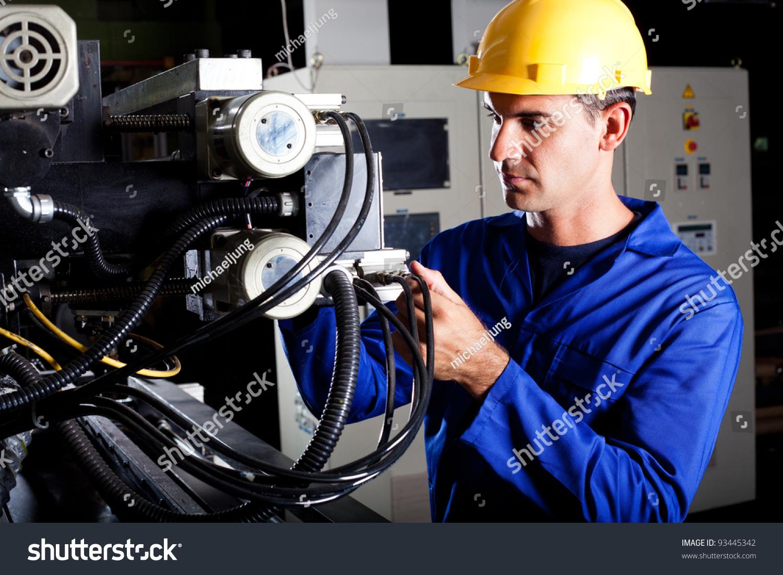 Modern Industrial Machine Operator Working On Photo 93445342 – Machine Mechanic