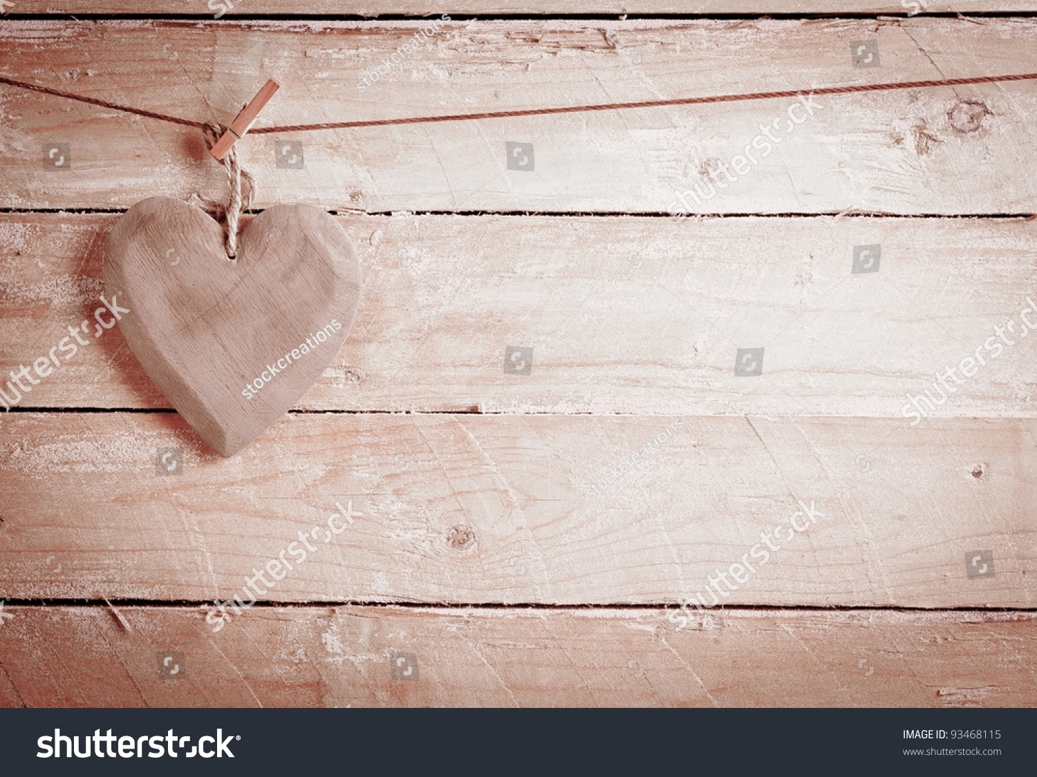 Quaint rustic wooden heart hanging peg stock photo for Rustic concept