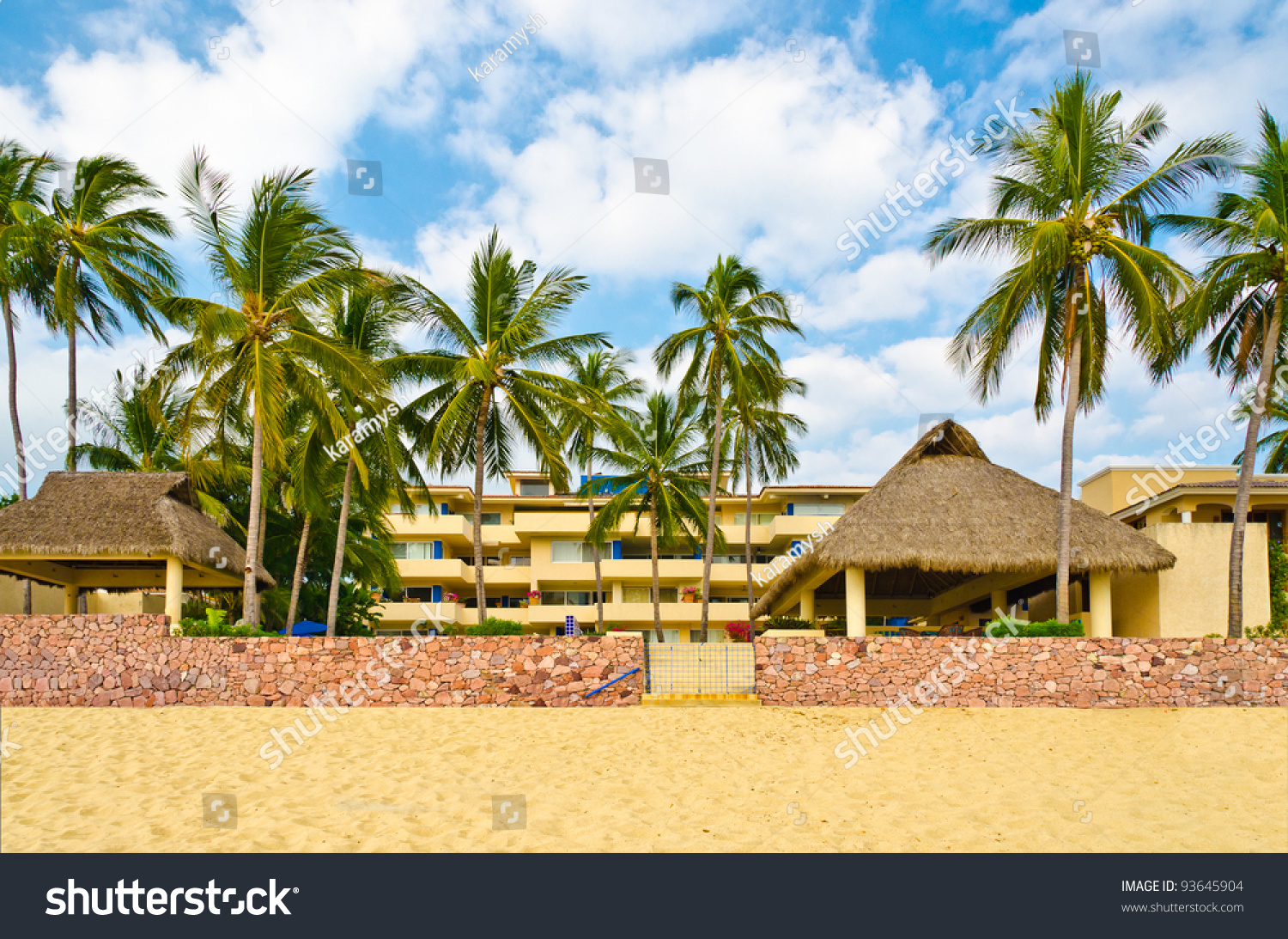 Large tropical beach house with red stone wall over nice for Large beach house