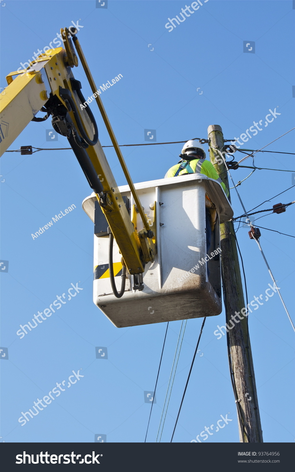 a telecomelectrical engineer using a mobile elevating