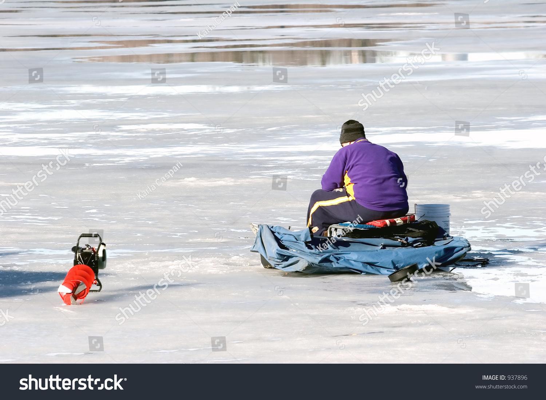 A Minnesota Man Ice Fishing On Lake Nokomis Stock Photo