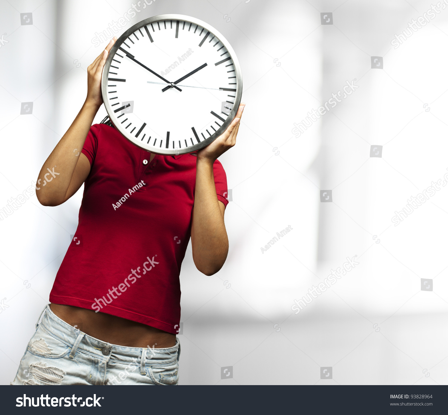 Woman Holding A Clock In Front Of Her Head Against An ...