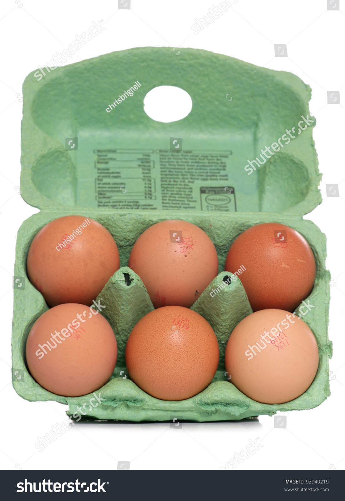 half dozen eggs on white background