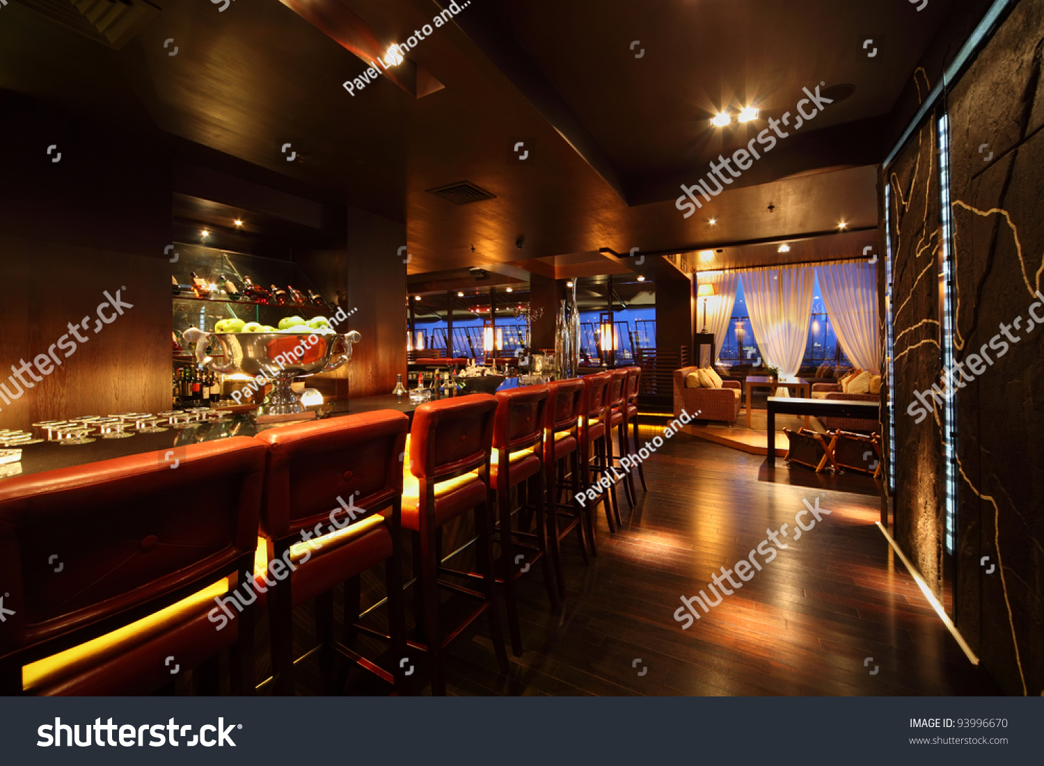 Bar Counter With Chairs In Empty Comfortable Restaurant At Night