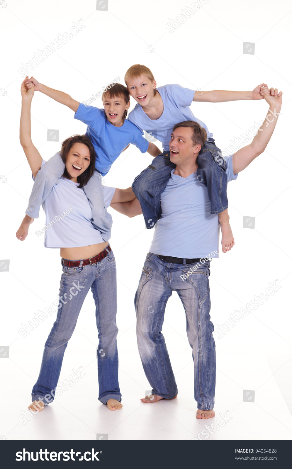 Cute family of a four in blue clothes