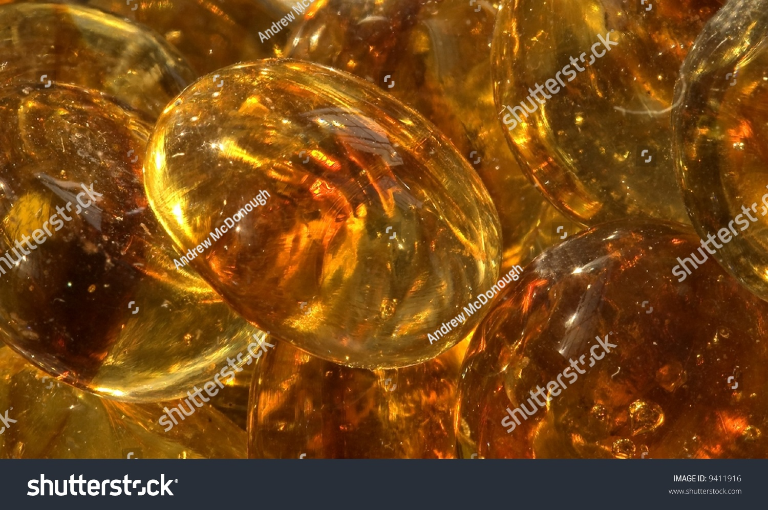 Closeup amber colored glass beads vase stock photo 9411916 close up of amber colored glass beads in a vase with natural back lighting reviewsmspy