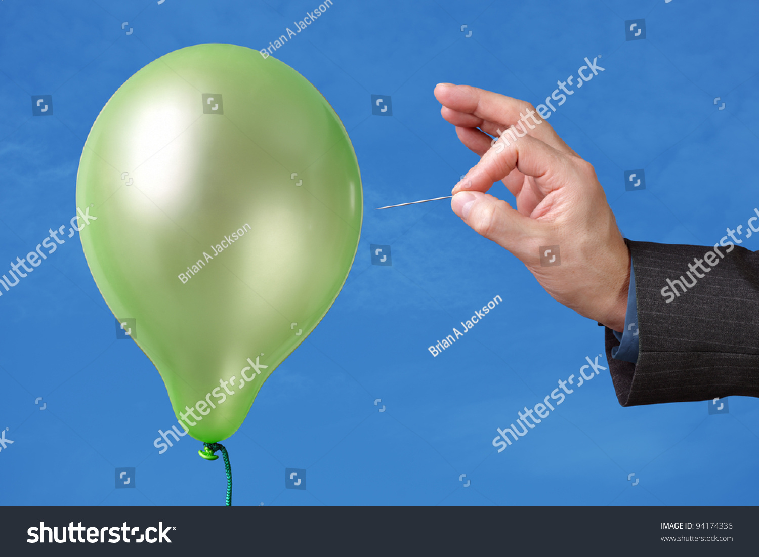 stock-photo-needle-about-to-pop-a-green-