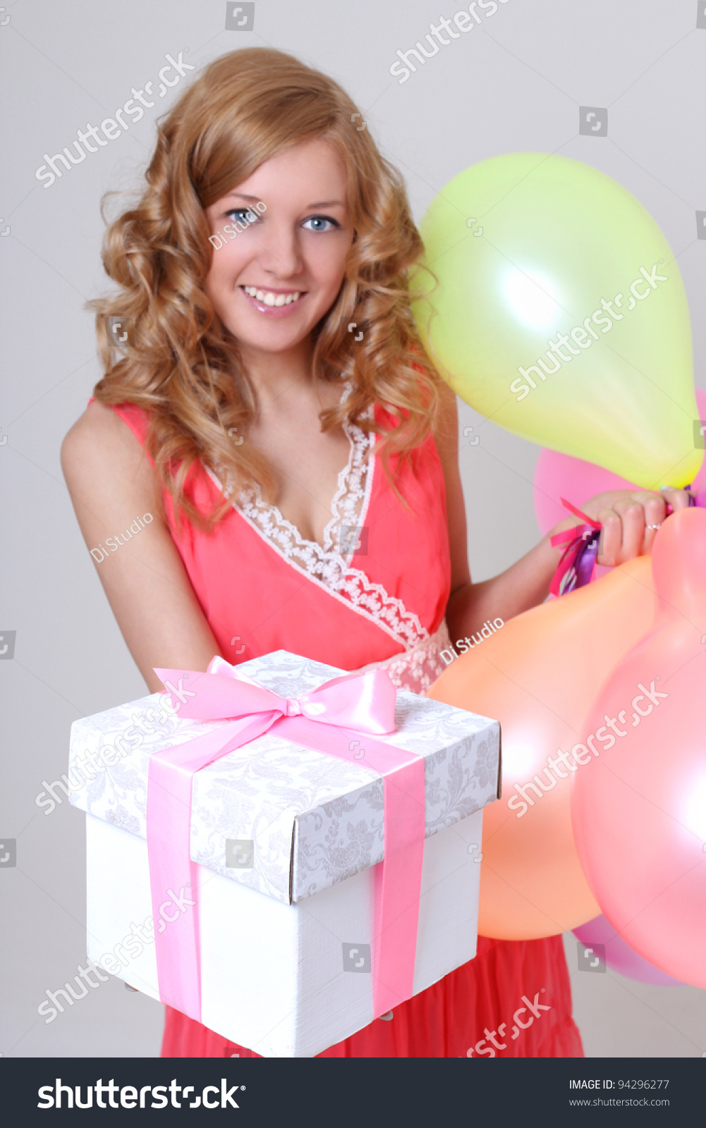 Happy Birthday Girl With Balloons Showing Her Gift
