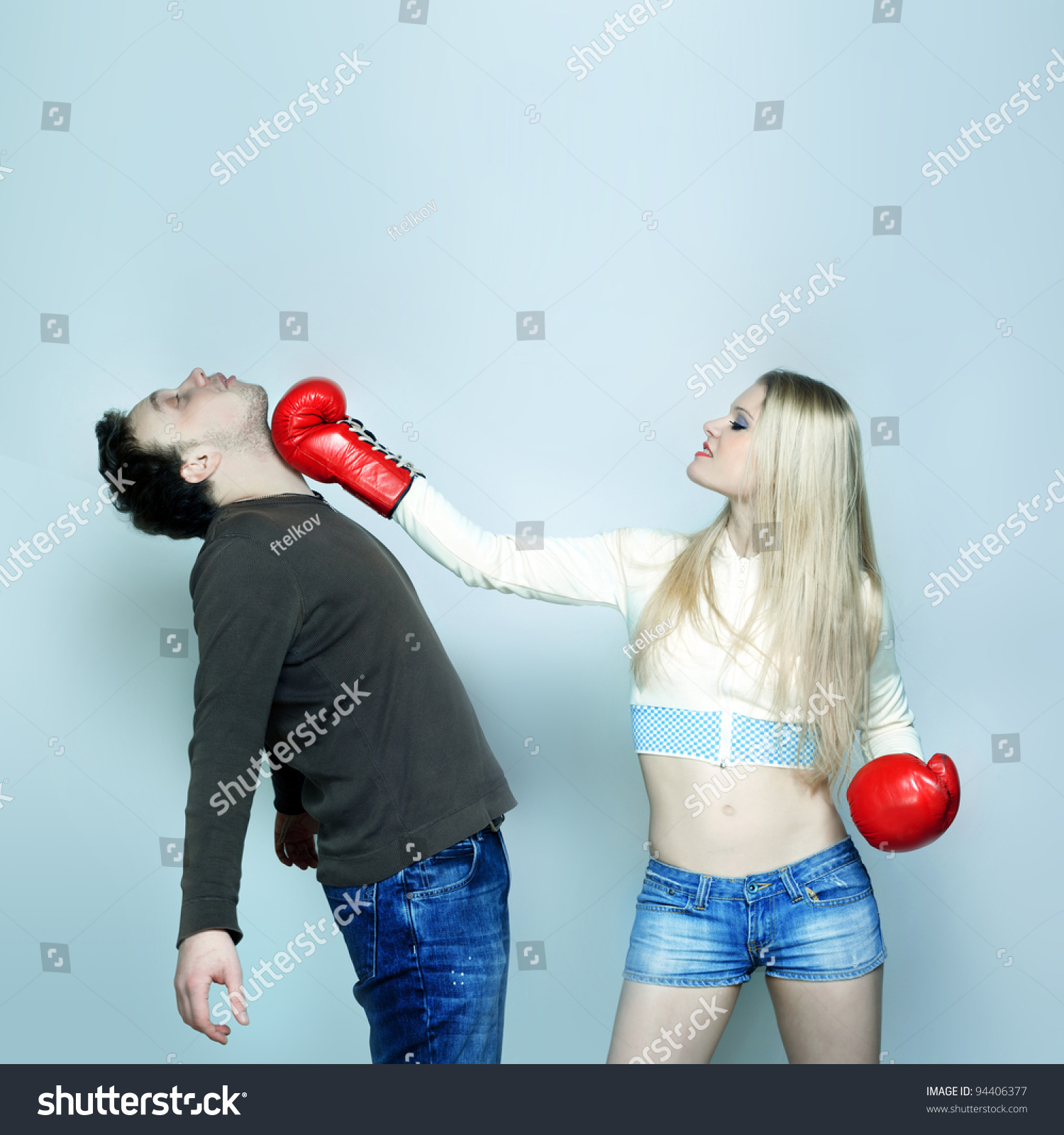 beautiful funny couple expressive fighting stock photo