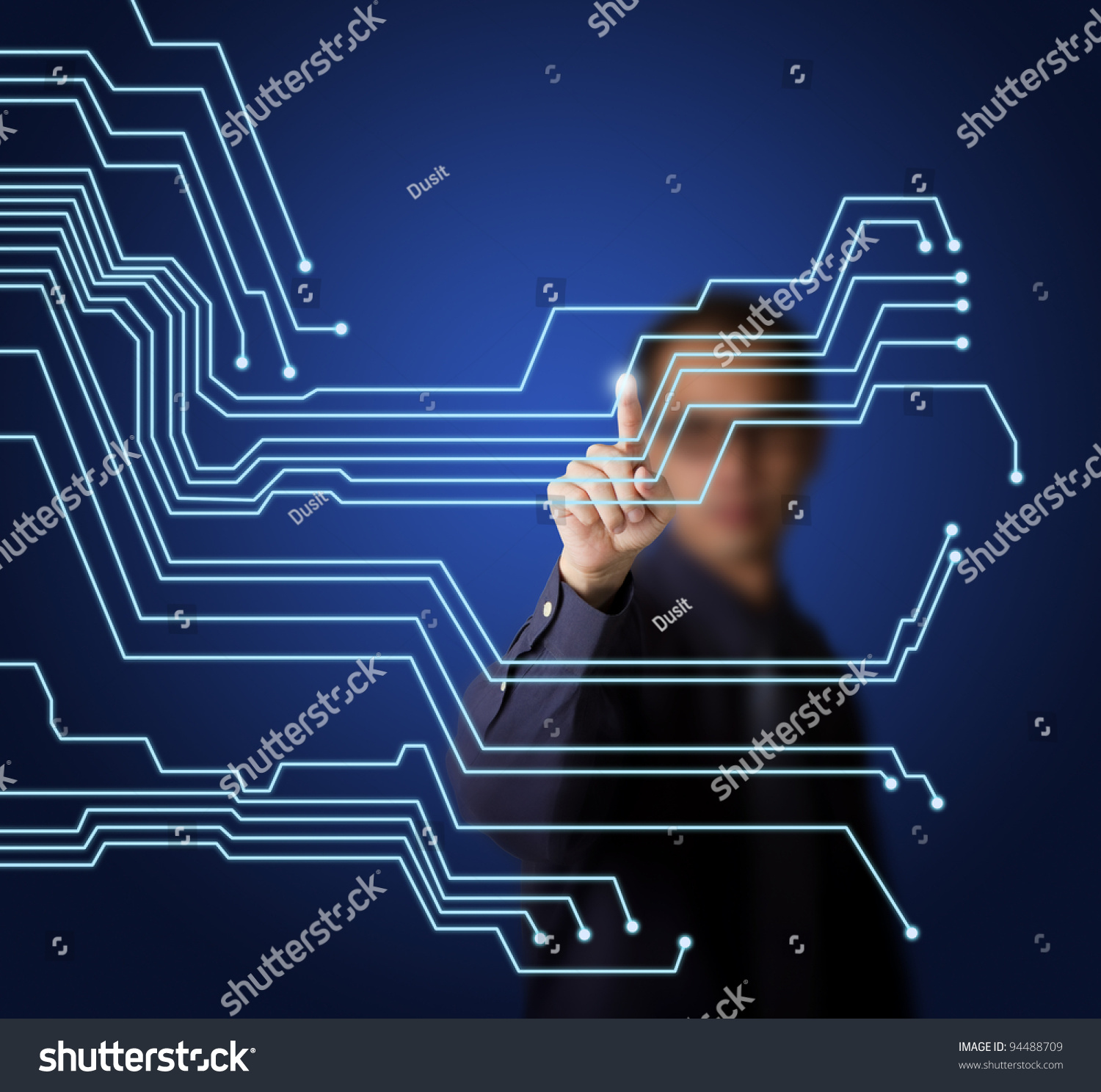 business man pointing virtual electronic circuit stock photo (editbusiness man pointing at virtual electronic circuit board on touchscreen