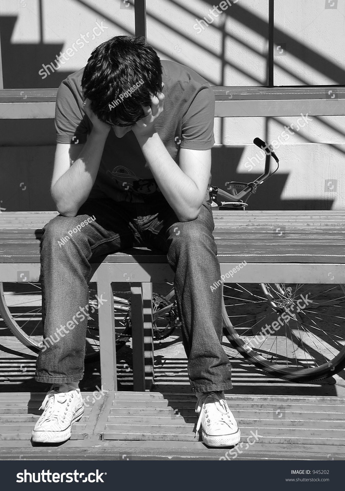 sad boy stock photo edit now 945202 shutterstock