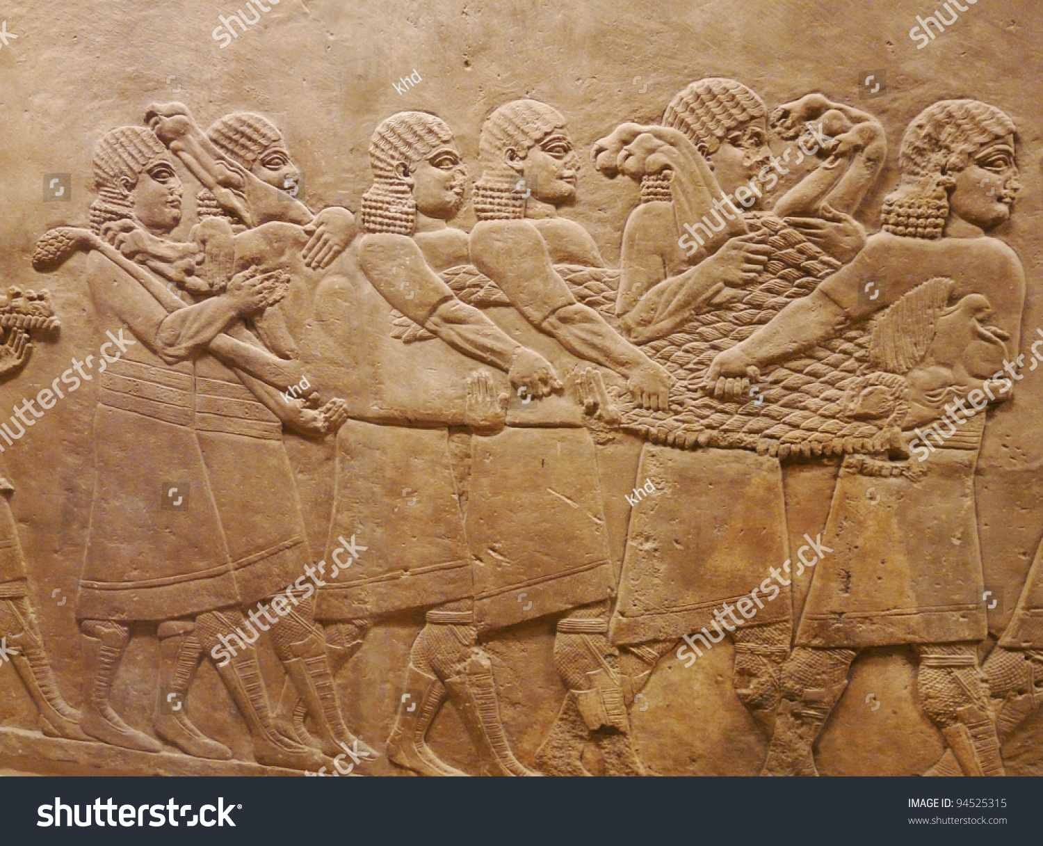 Ancient assyrian wall carvings men on stock photo