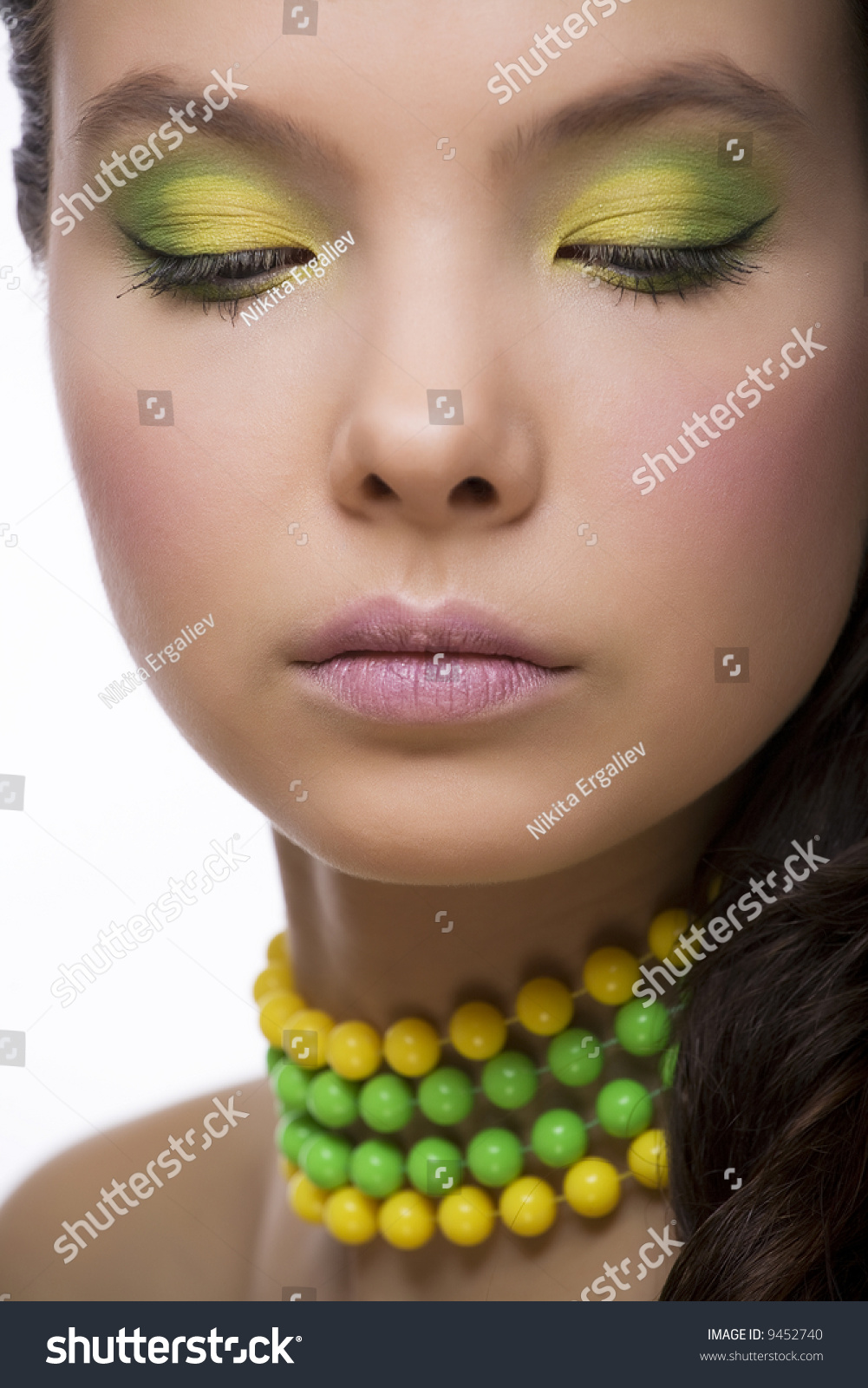 green and yellow make up with beads stock photo 9452740 shutterstock. Black Bedroom Furniture Sets. Home Design Ideas