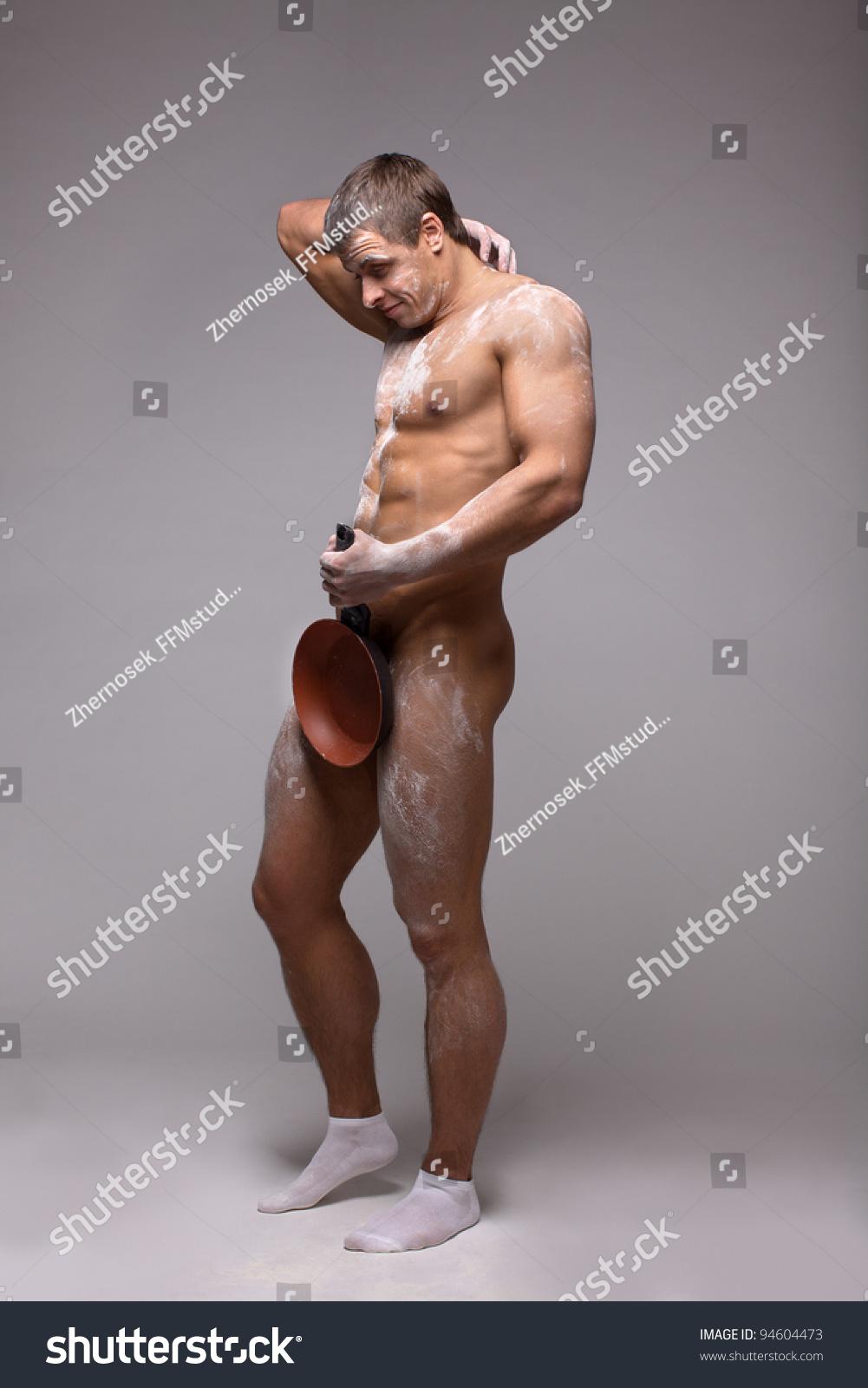 beautiful naked man athlete frying pan stock photo (royalty free