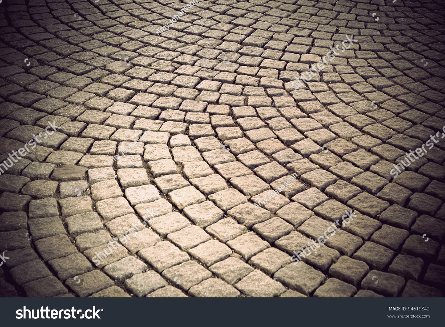 Background of vintage street with cobblestone in circular for Cobblestone shutters
