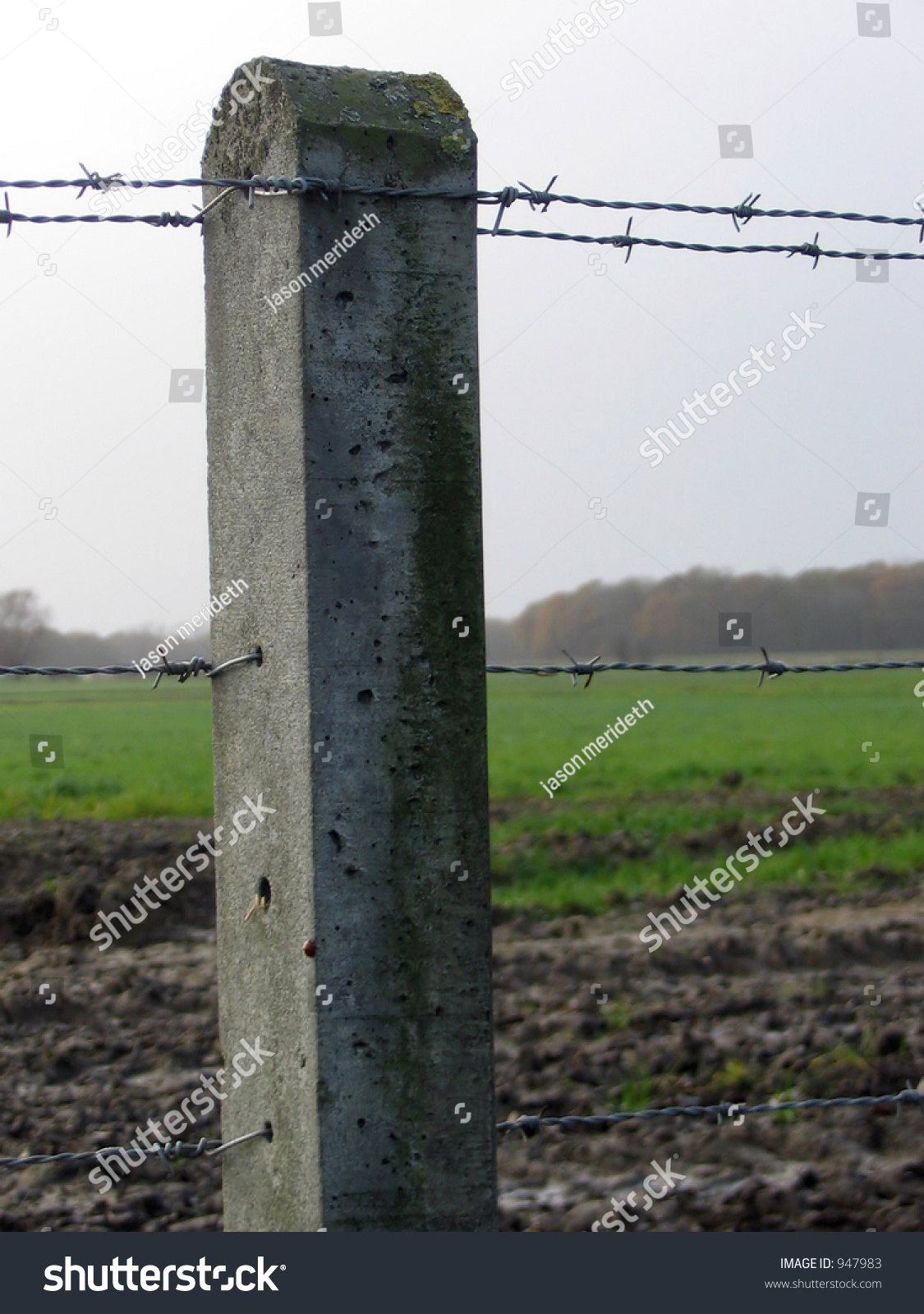 concrete barbed wire fence post field stock photo 947983