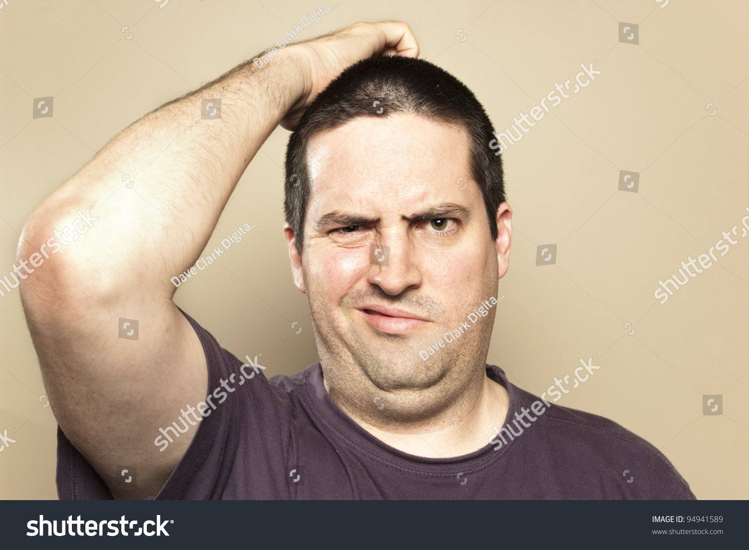 confused man scratching head stock photo edit now 94941589