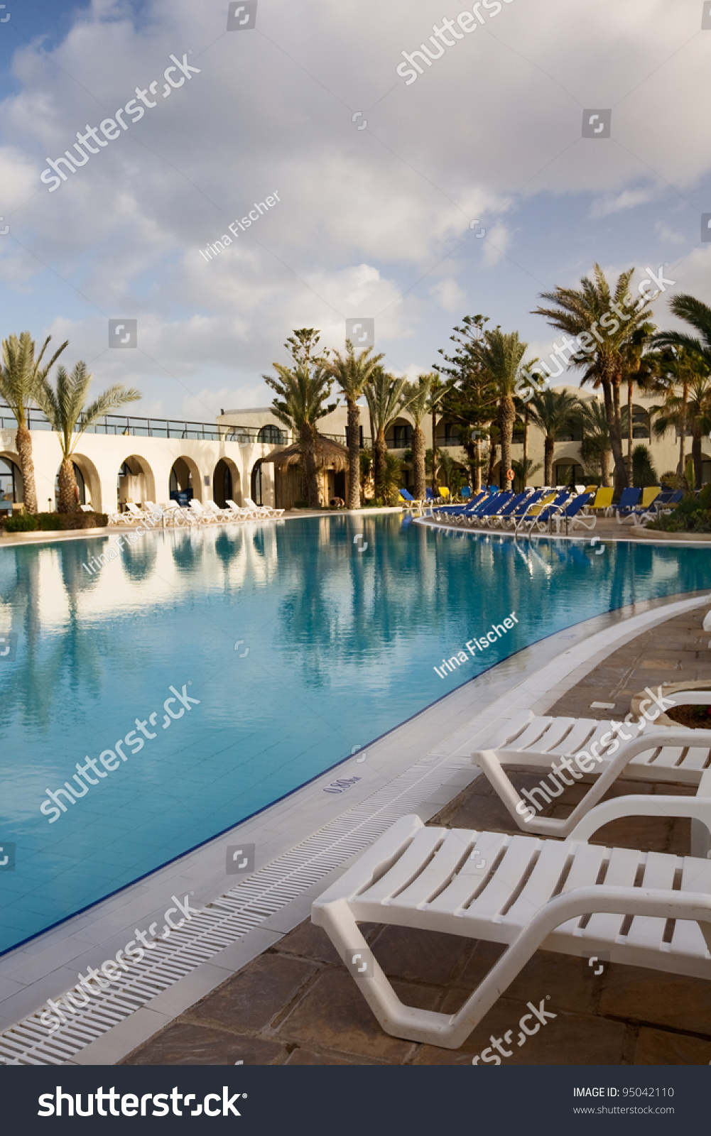 Lounge Chairs Next To Hotel Swimming Pool Island Of Djerba Tunisia Africa Stock Photo