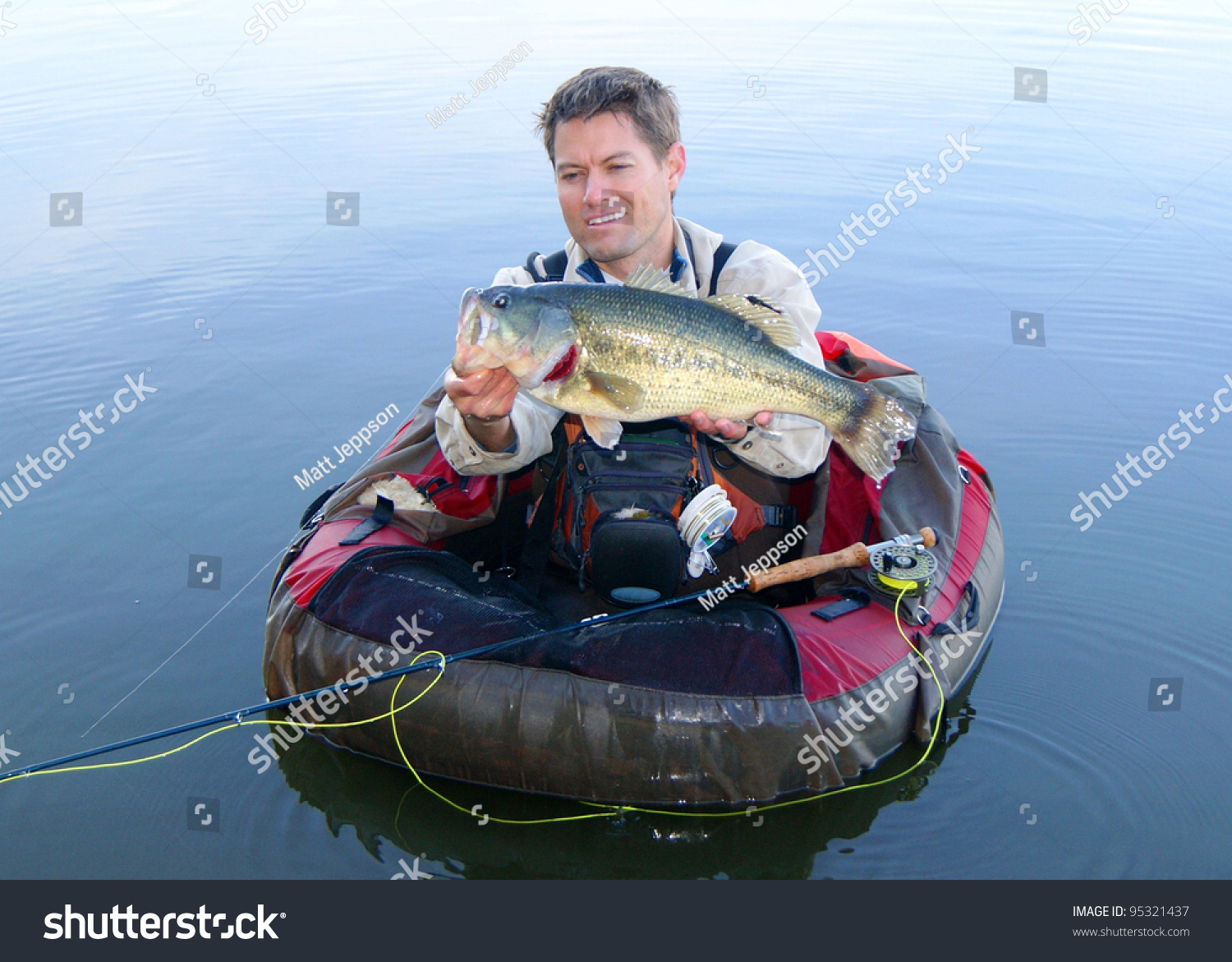 Fly fisherman pontoon float tube belly stock photo for Float tubes for fishing