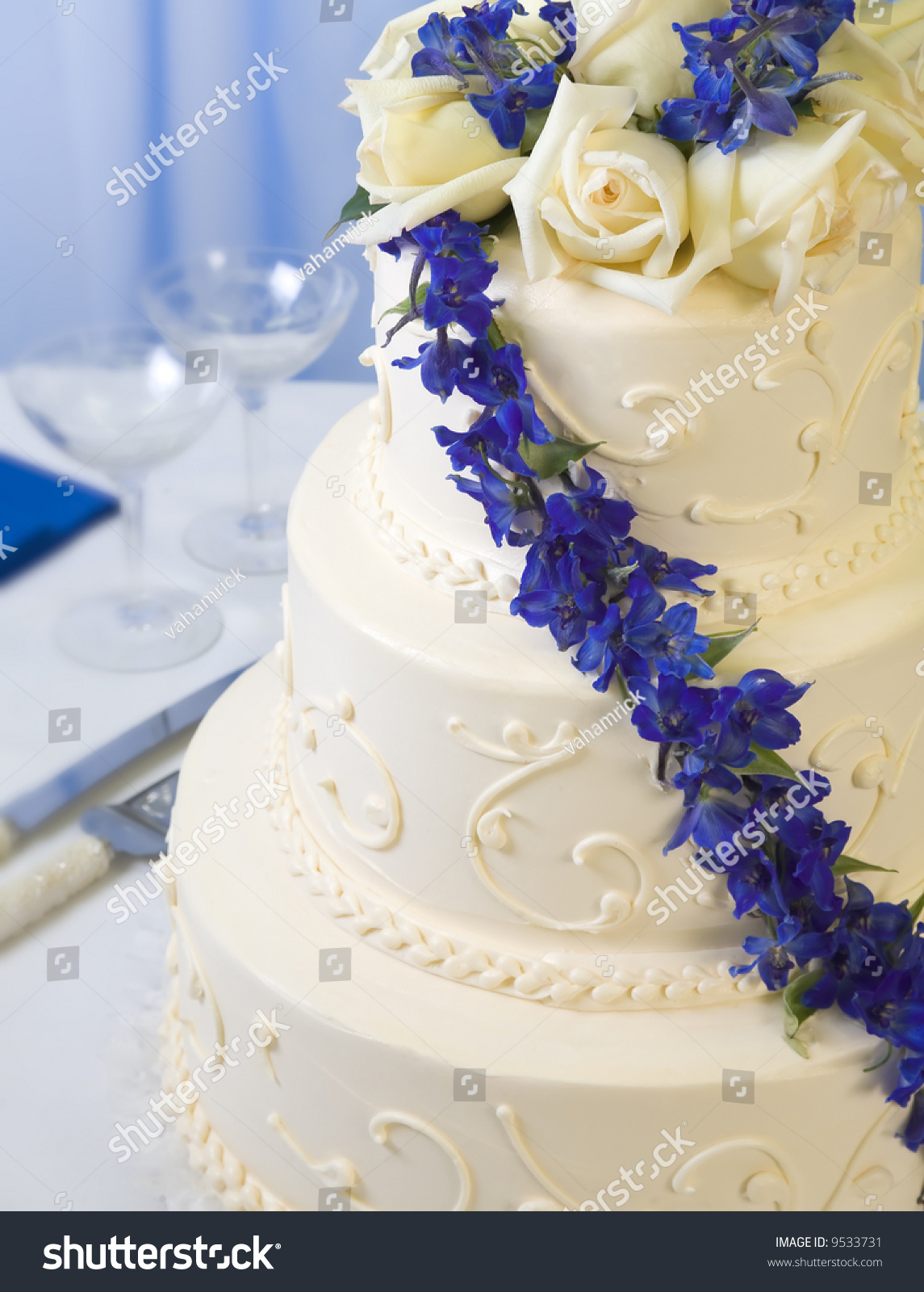 Traditional Decorated Wedding Cake With Blue Delphiniums