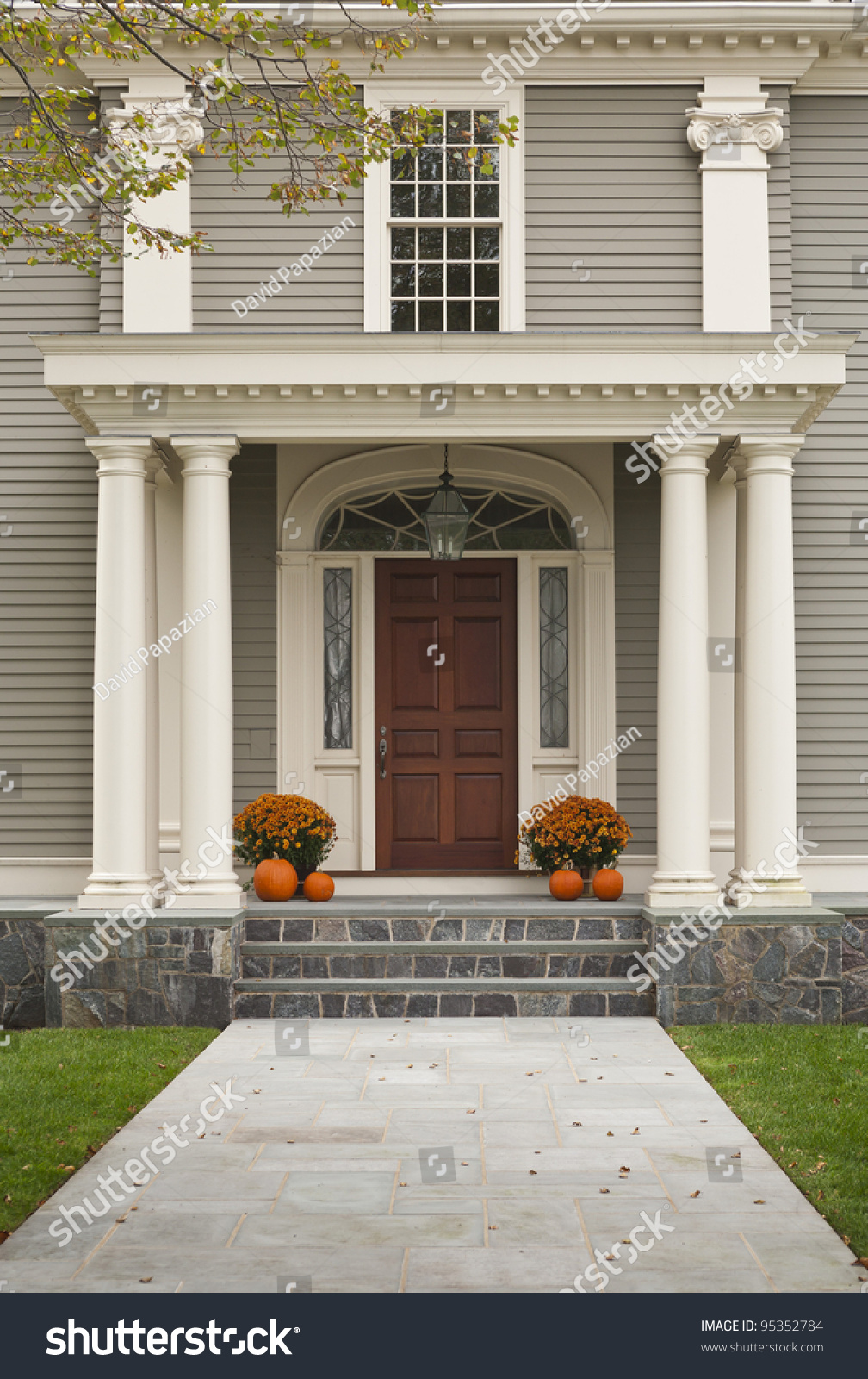 Front Door of Home showing two pillars with arch and twin flowerpots with four pumpkins & Front Door Home Showing Two Pillars Stock Photo 95352784 ... Pezcame.Com